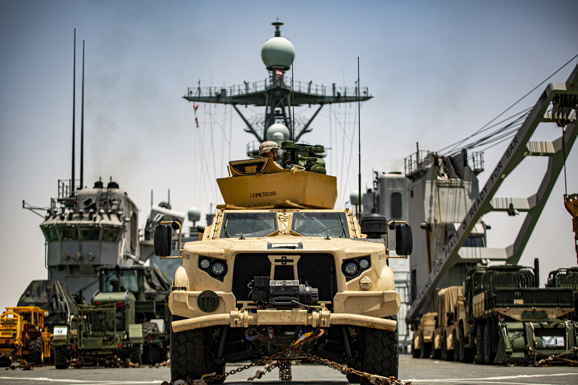 A Marine in a joint light tactical vehicle provides rear security aboard dock landing ship USS Carter Hall (LSD 50) while transiting the Suez Canal, June 1, 2021. (1st Lt. Mark Andries/Marine Corps)