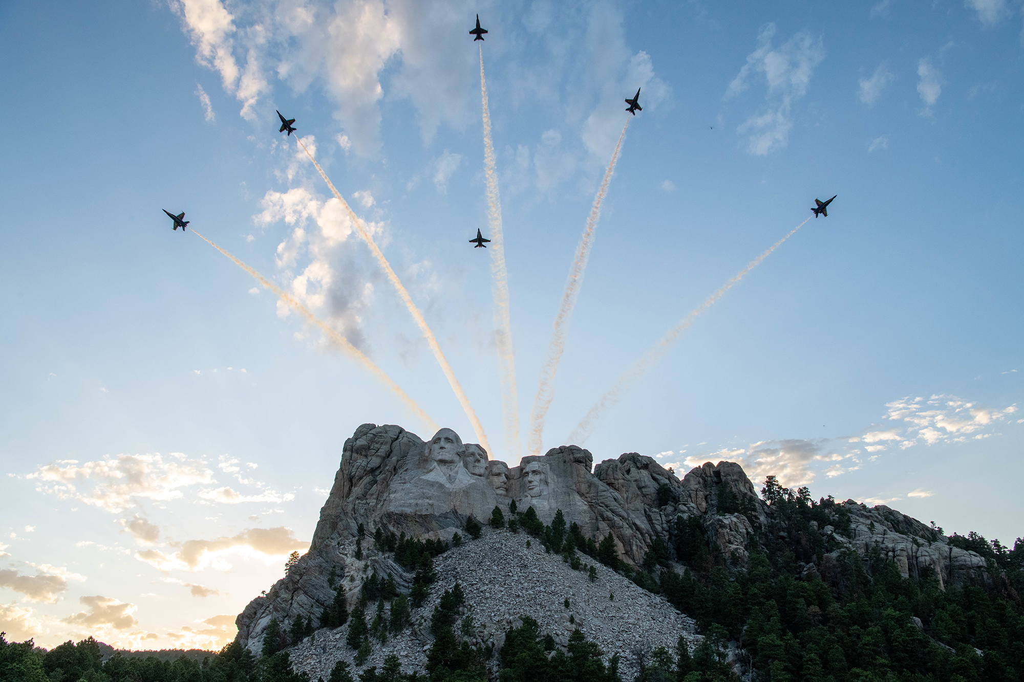 Blue Angels F-18 Hornets fly over Mount Rushmore during a