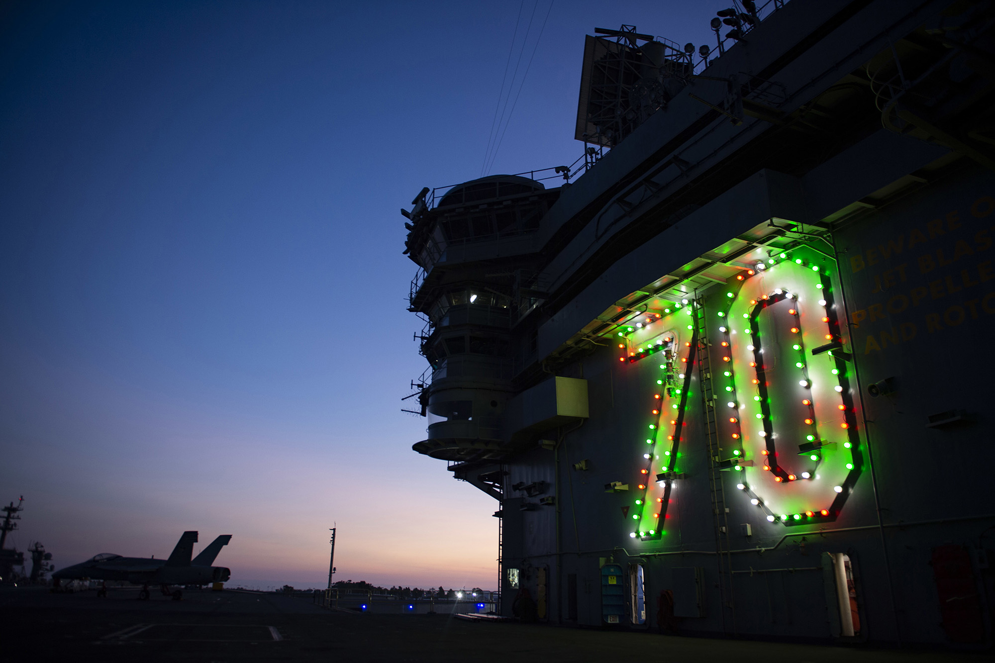 The Nimitz-class nuclear aircraft carrier USS Carl Vinson (CVN 70) displays holiday lights on the island in celebration of the holiday season on Nov. 26, 2020, in San Diego. (MC2 Matthew A. Fink/Navy)