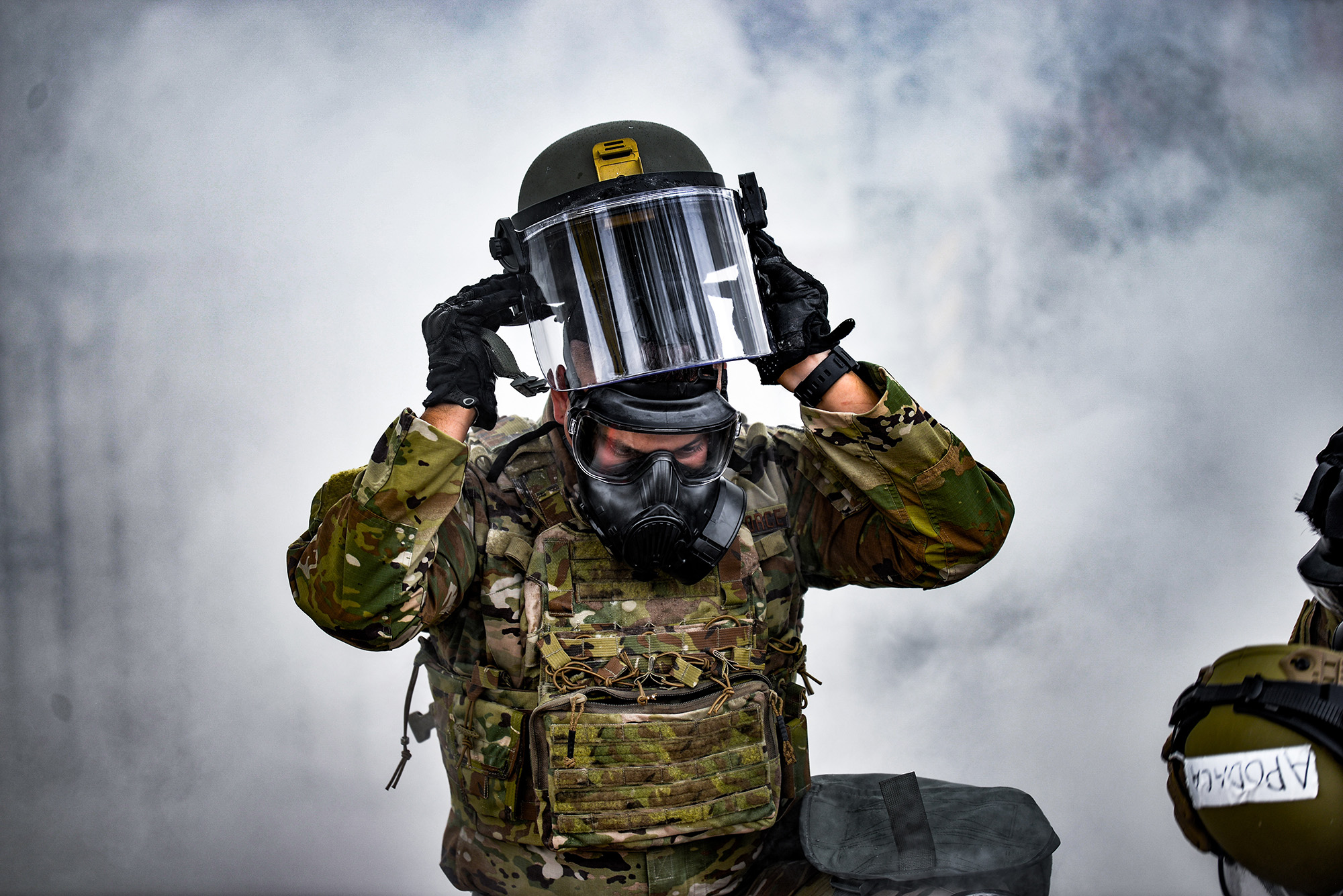 Tech. Sgt. Estevan Jojola puts on his face shield during a training exercise in Albuquerque, N.M., Aug. 17, 2020. (Senior Airman Ian Beckley/Air Force)