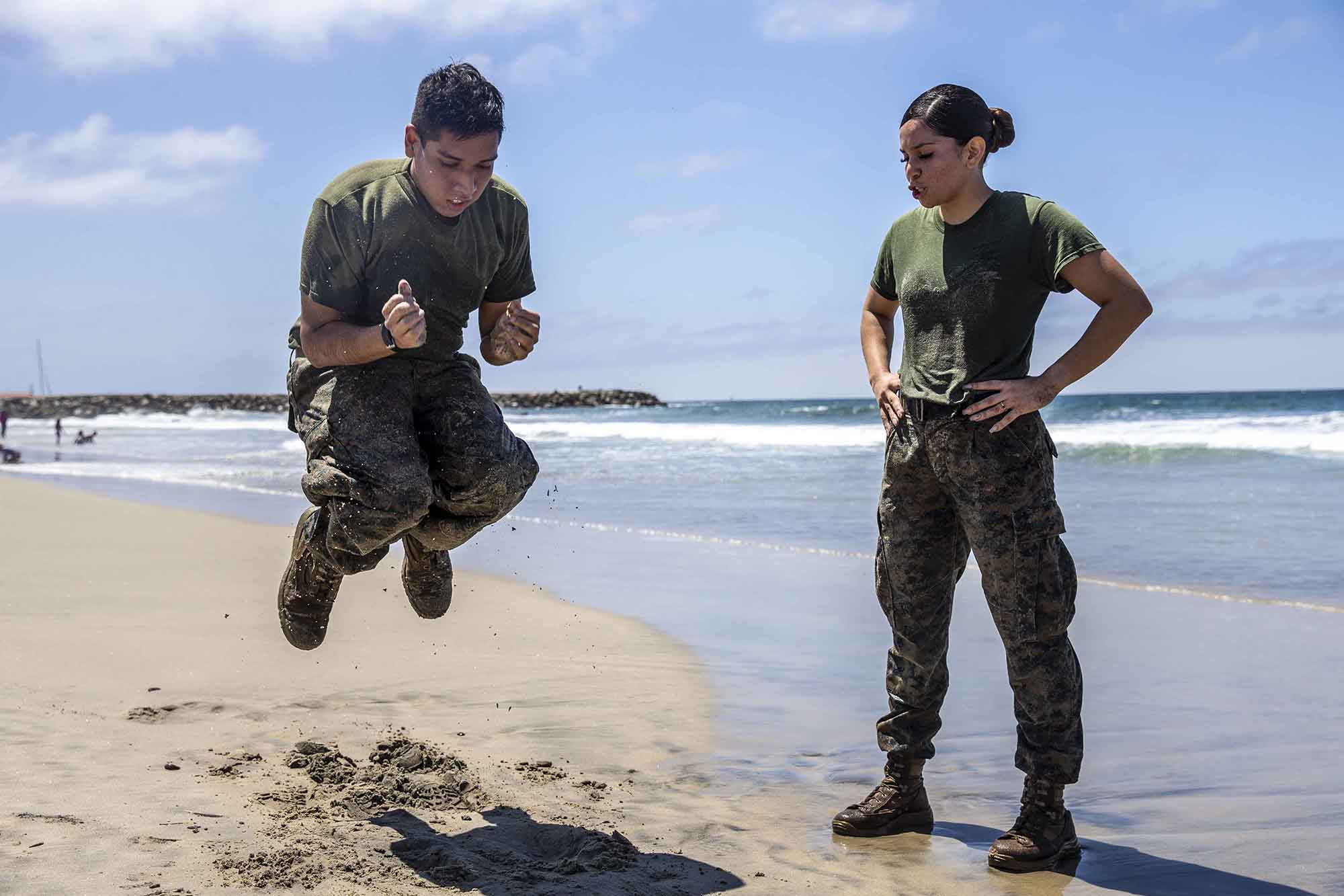 U.S. Marine Sgt. Roxanne Gorostieta motivates a fellow Marine during a physical training session at Del Mar Beach on Marine Corps Base Camp Pendleton, Calif., Aug. 5, 2020. (Lance Cpl. Alison Dostie/Marine Corps)