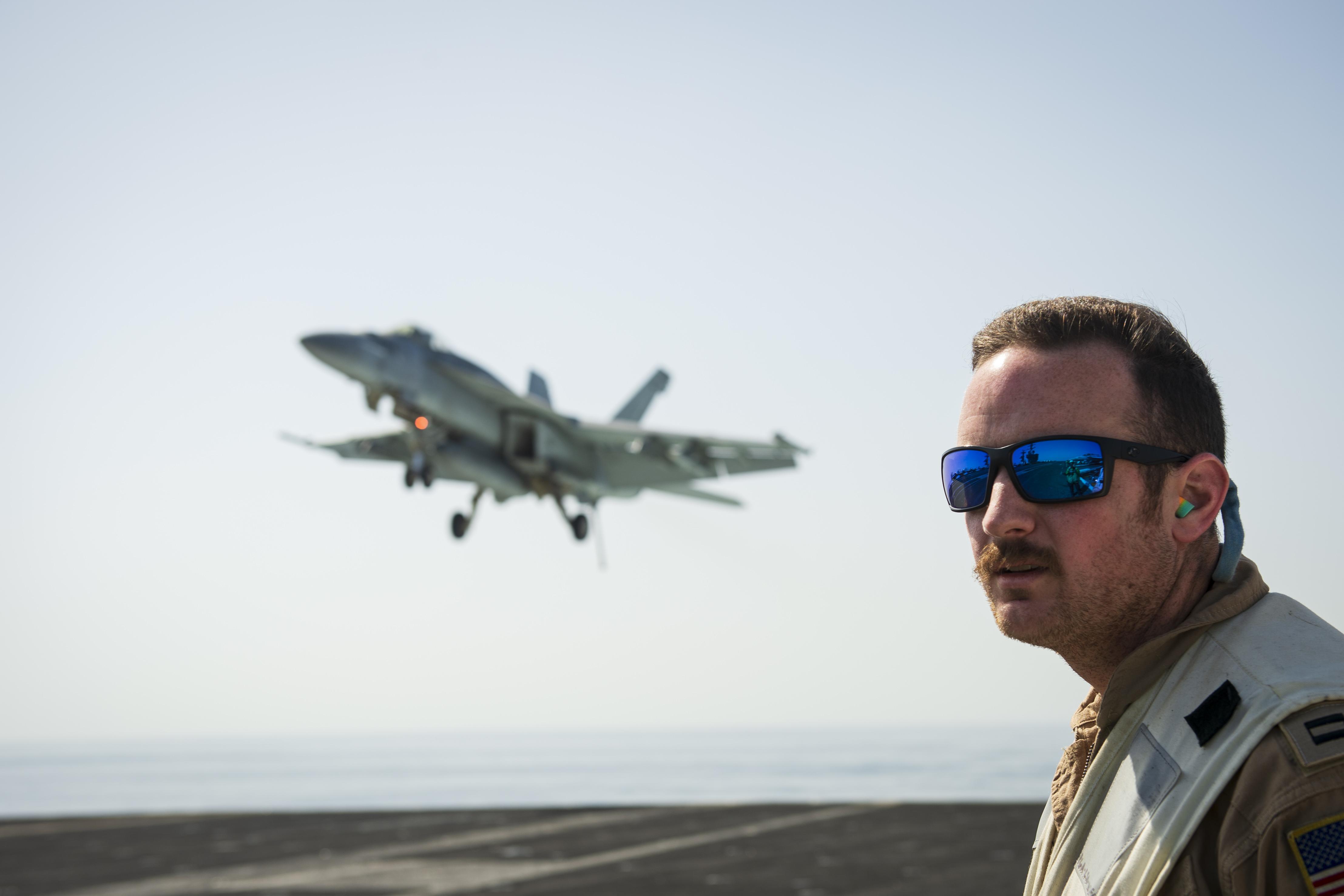 Lt. Tyler Fisher spots the deck as an F/A-18E Super Hornet prepares to land aboard the U.S. Navy aircraft carrier Dwight D. Eisenhower. (MC3 Hillary Becke/U.S. Navy)