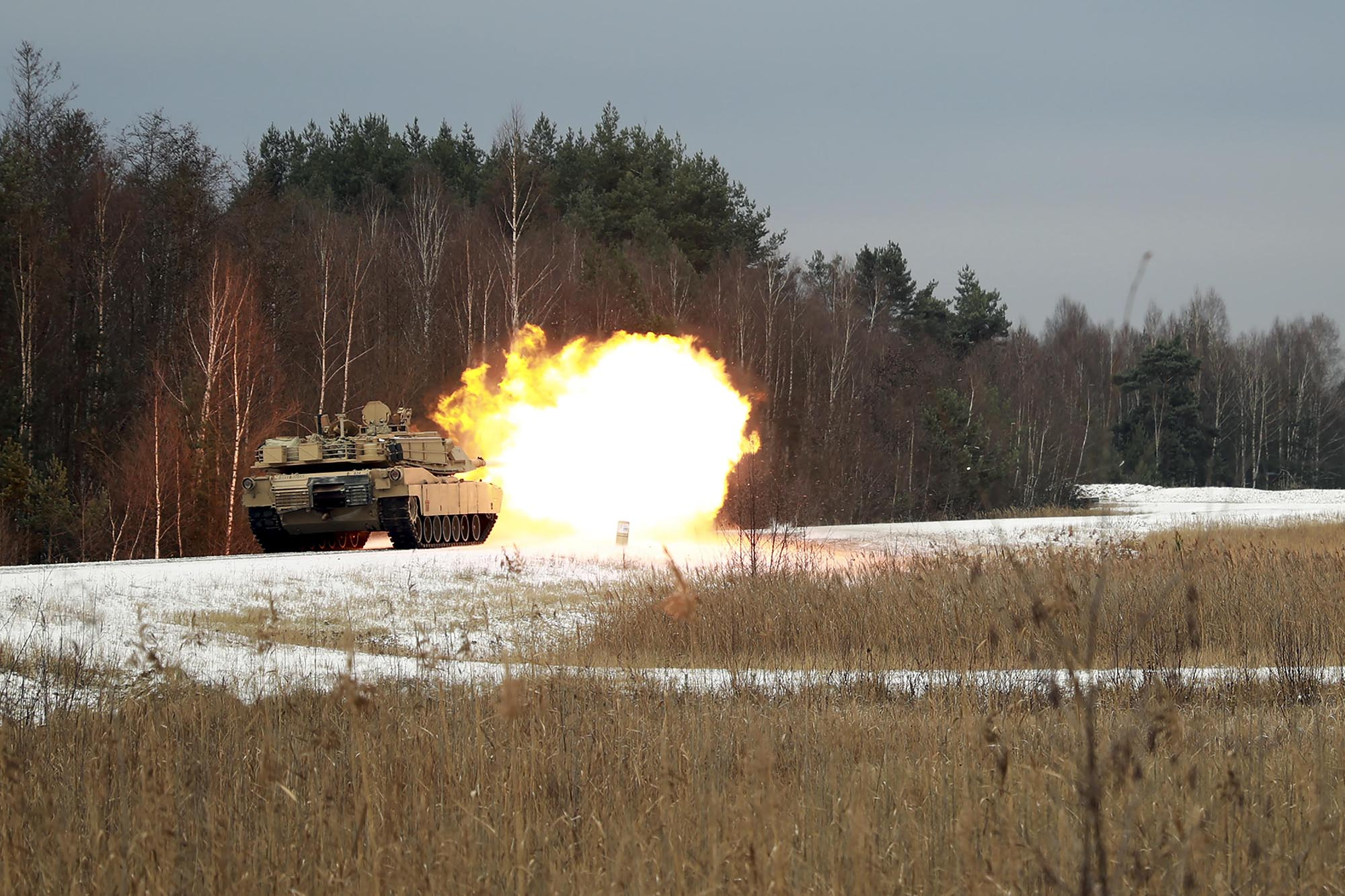 An M1 Abrams Main Battle Tank assigned to the 2nd Battalion, 5th Cavalry Regiment, 1st Armored Brigade Combat Team, 1st Cavalry Division, fires its main gun at Grafenwoehr Training Area, Germany, Dec. 2, 2020. (Army)