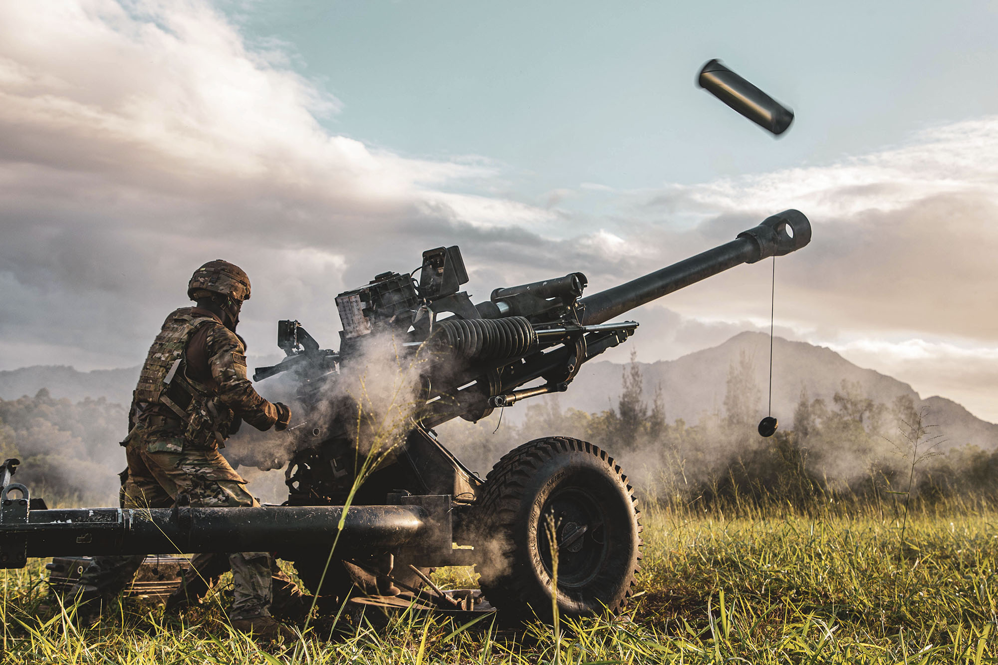 Service members participate in an exercise called Operation Wardog Kila for a joint live-fire exercise at Schofield Barracks, Hawaii, Dec. 30, 2020, with the 25th Combat Aviation Brigade, 25th Infantry Division Artillery units and the U.S. Marine Corps. (Sgt. Sarah D. Sangster/Army)