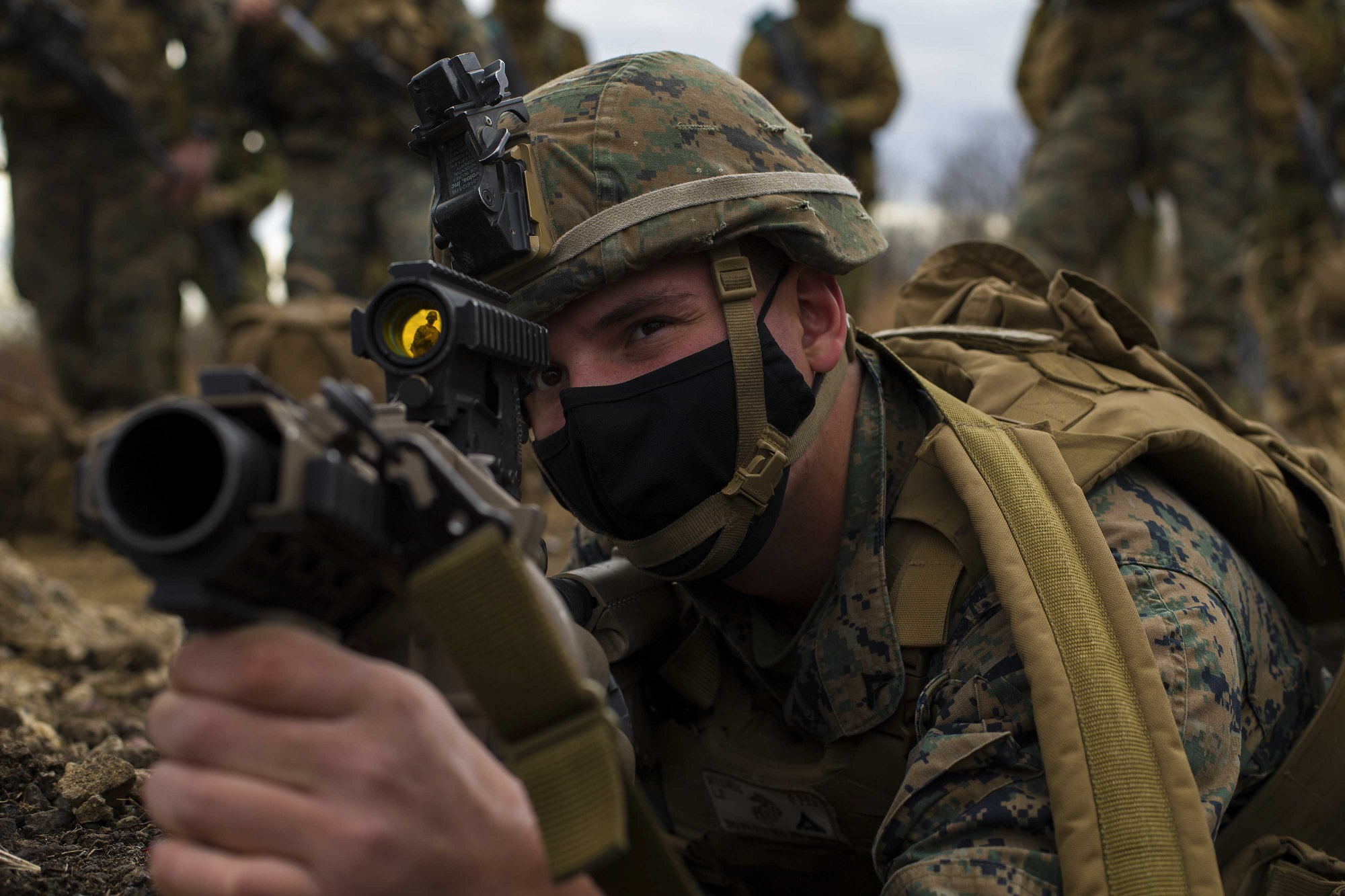 Marine Corps Lance Cpl. Lucas Mitchell looks through the scope of an M32 multi-grenade launcher in Niigata, Japan, Dec. 10, 2020, during Forest Light, an annual bilateral exercise with U.S. and Japanese forces. (Lance Cpl. Jonathan Willcox/Marine Corps)