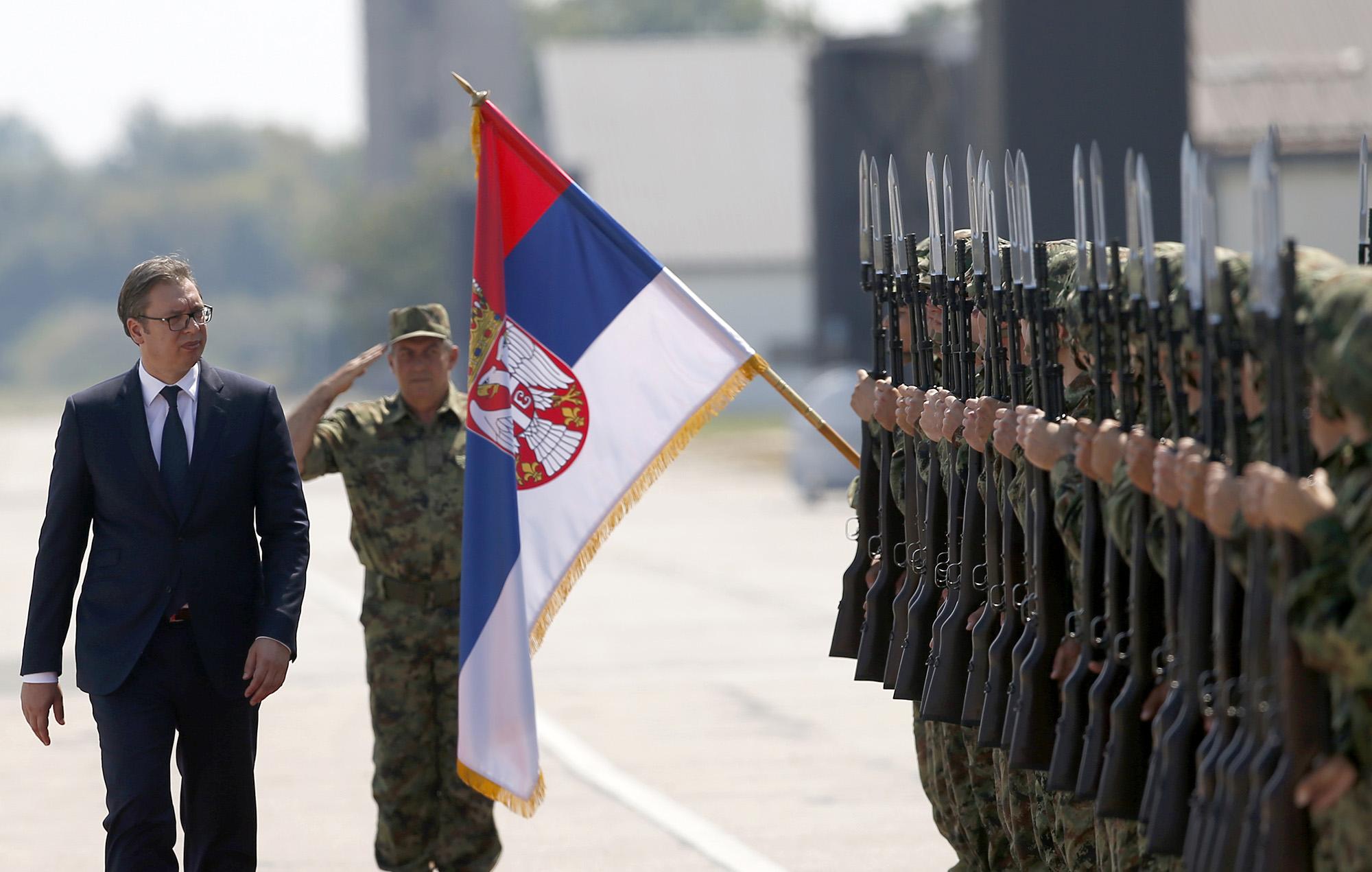 In this Aug. 21, 2018, file photo, Serbian President Aleksandar Vucic, left, reviews an honor guard on the tarmac at Batajnica, military airport near Belgrade, Serbia. (Darko Vojinovic/AP)