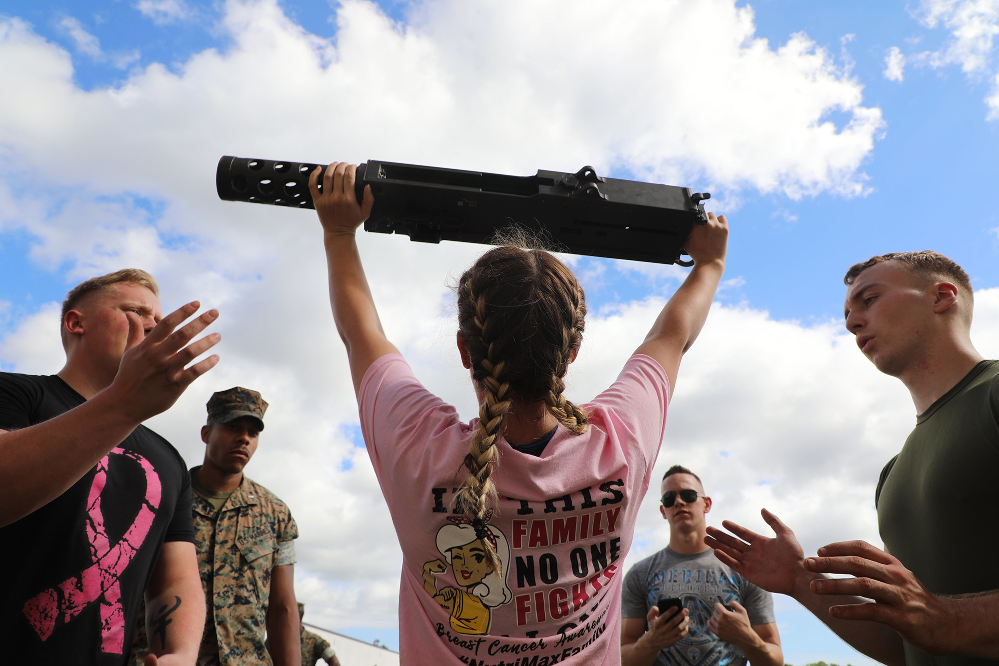 Cpl. Alexandra Veal executes an overhead press with an M2 .50 caliber machine gun during the unit's Warrior Week competition at Camp Lejeune, N.C., Oct. 15, 2020. (Lance Cpl. David I. Romero/Marine Corps)