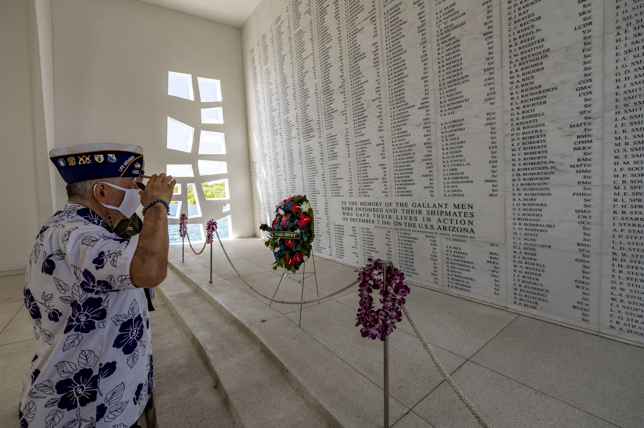 Henry Lee, a Pearl Harbor survivor and U.S. Army veteran, renders honors in the USS Arizona Memorial shrine room on Dec. 7, 2020, as part of the 79th Pearl Harbor Day Remembrance Day ceremony in Honolulu, Hawaii. (MC2 Charles Oki/Navy)