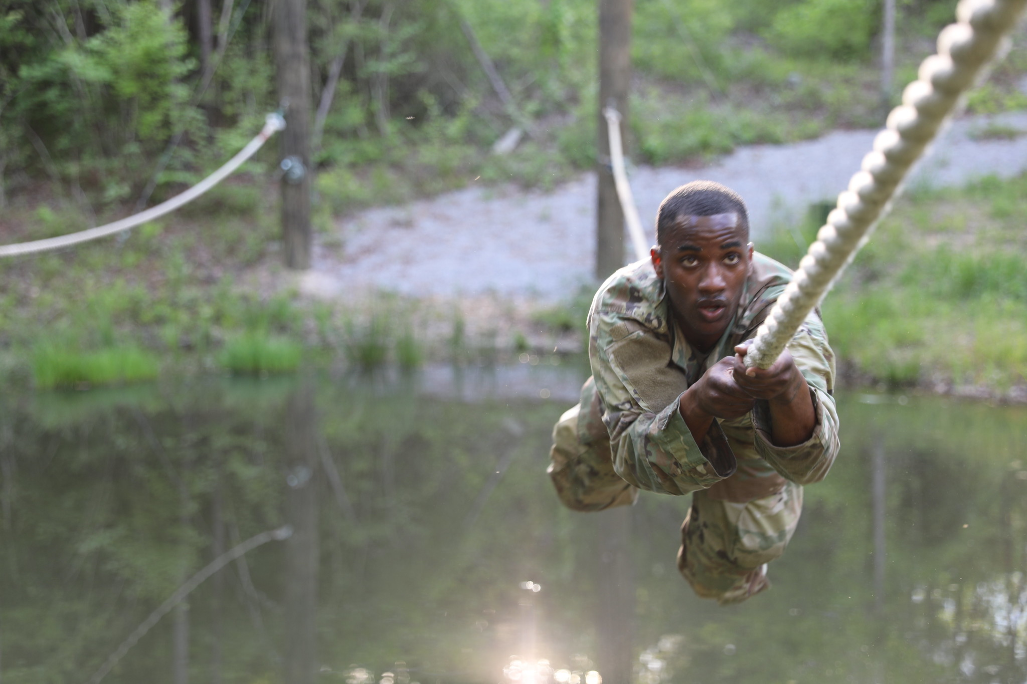 Spc. Kysam Moody moves through the obstacle course at the Mississippi National Guard Best Warrior Competition at Camp Shelby Joint Forces Training Center, near Hattiesburg, Miss., April 20, 2020. (Spc. Benjamin Tomlinson/Army National Guard)