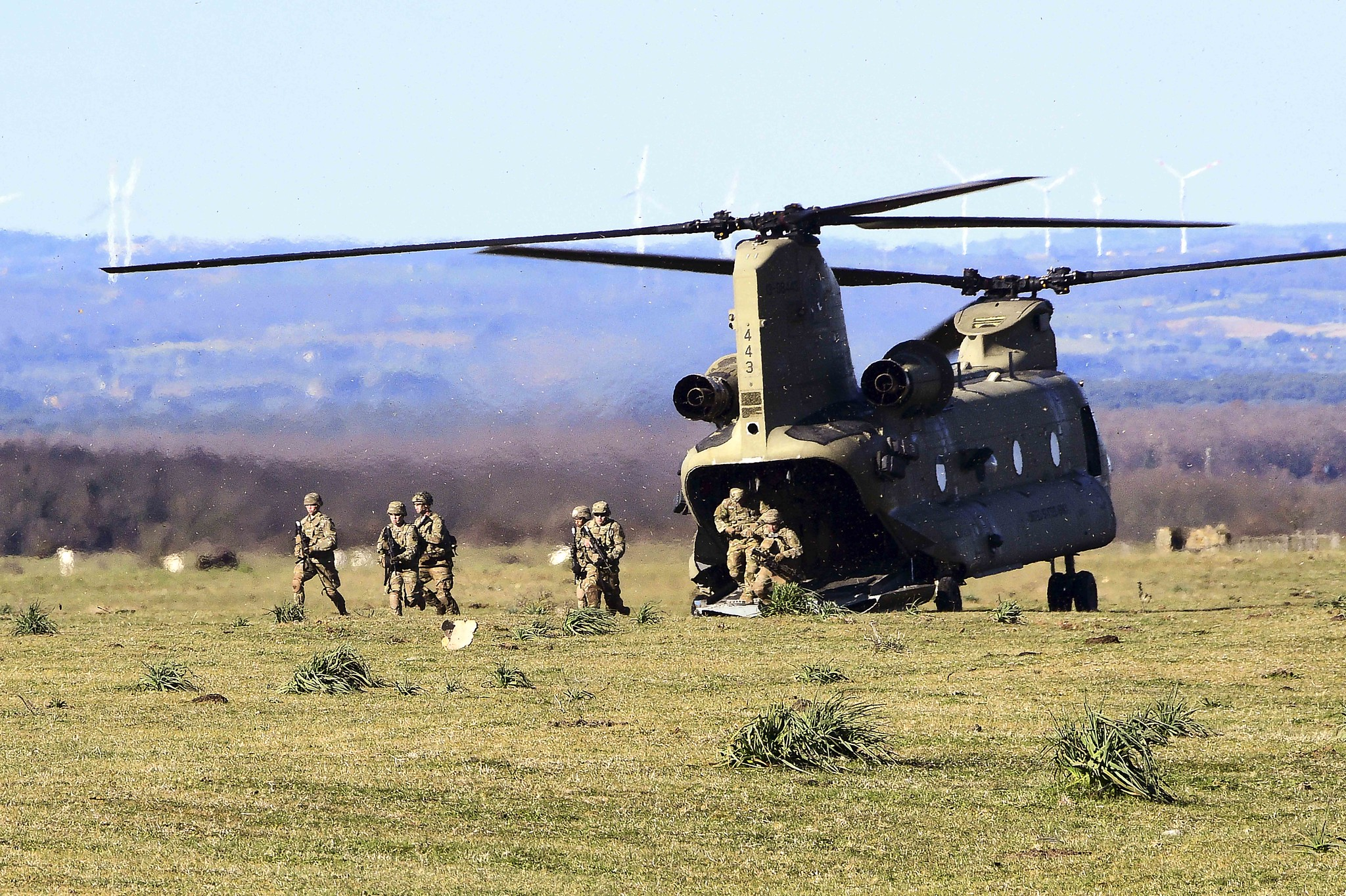 Soldiers conduct a simulated air assault from an Army CH-47 Chinook during training at Monte Romano Training Area, Italy, Jan. 27, 2021. (Elena Baladelli/Army)