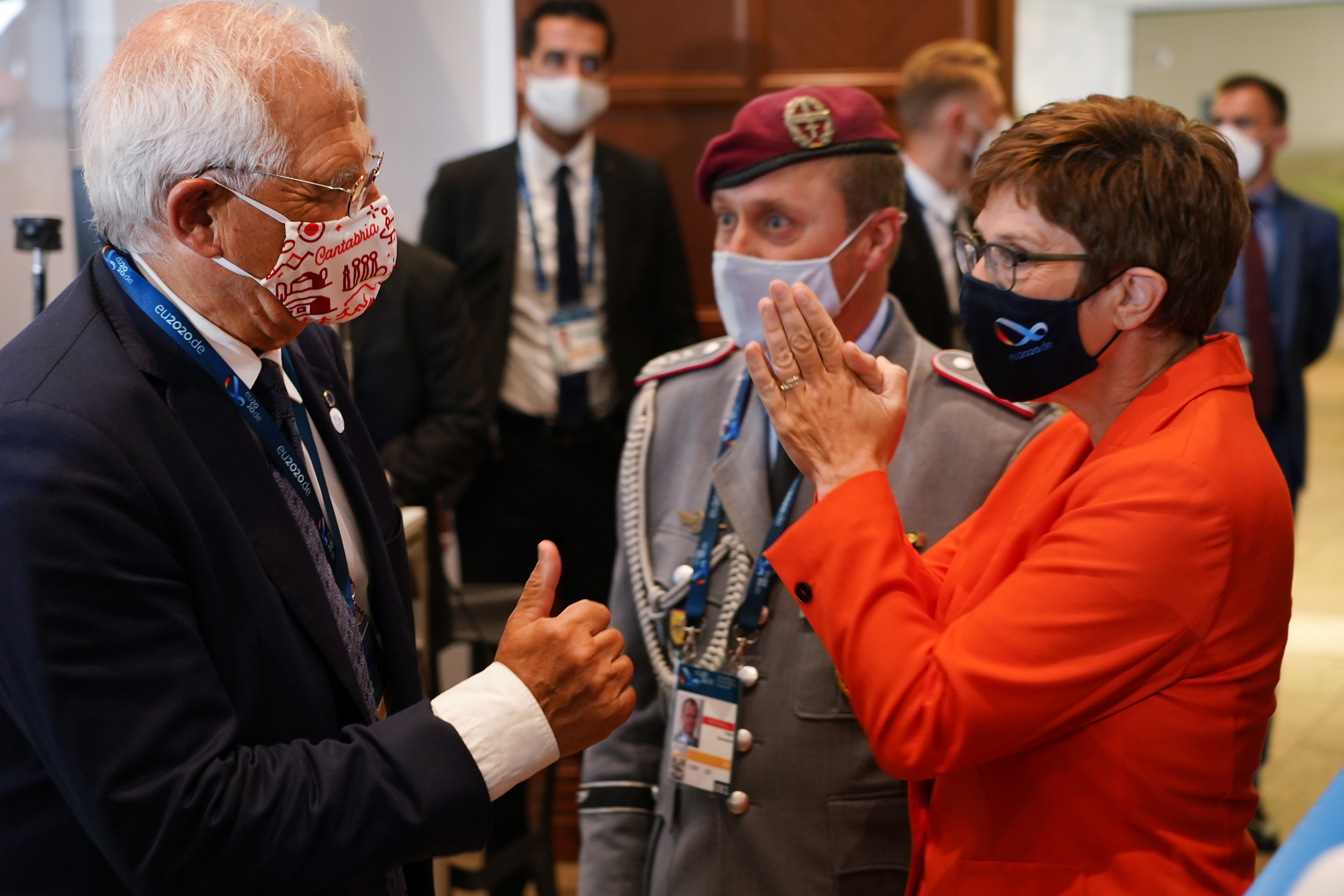 German Defence Minister Annegret-Kramp Karrenbauer, right, greets Josep Borell, left, high representative of the European Union for foreign affairs and security policy, at a meeting of EU defense ministers on Aug. 26, 2020, in Berlin. (Sean Gallup/Getty Images)