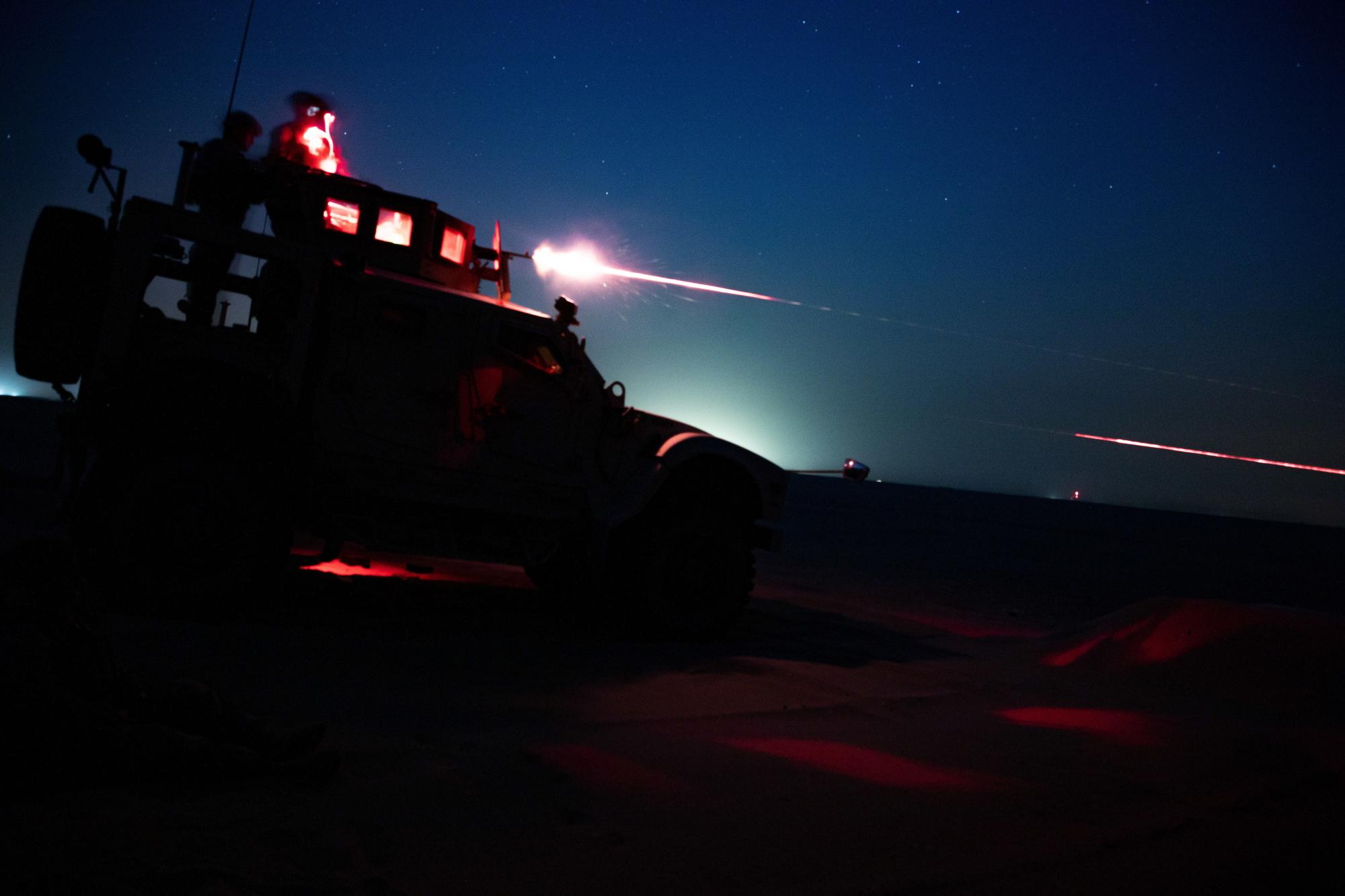 U.S. Marines fire an M240B from an MRAP All-Terrain Vehicle during night time machinegun range in Kuwait, June 16, 2020. (Cpl. Cutler Brice/Marine Corps)