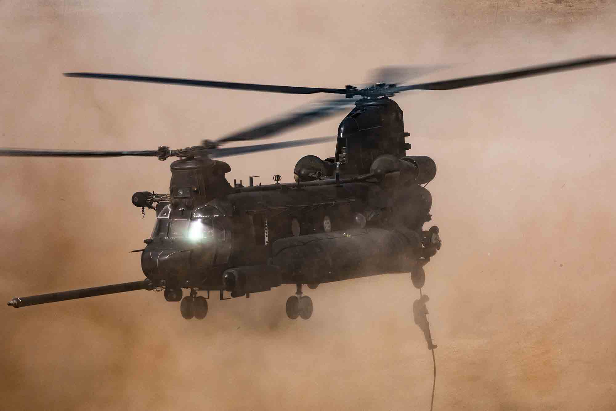 U.S. Army soldiers assigned to 19th Special Forces Group (Airborne), and Royal Moroccan Army soldiers fast-rope out of a CH-47 Chinook in Tifnit, Morocco, on June 14, 2021, during African Lion 2021. (Spc. Brendan Nunez/Army)
