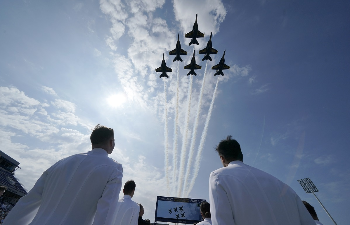 The Blue Angels fly over the graduation and commissioning ceremony at the U.S. Naval Academy in Annapolis, Md., Friday, May 28, 2021. (AP Photo/Julio Cortez)