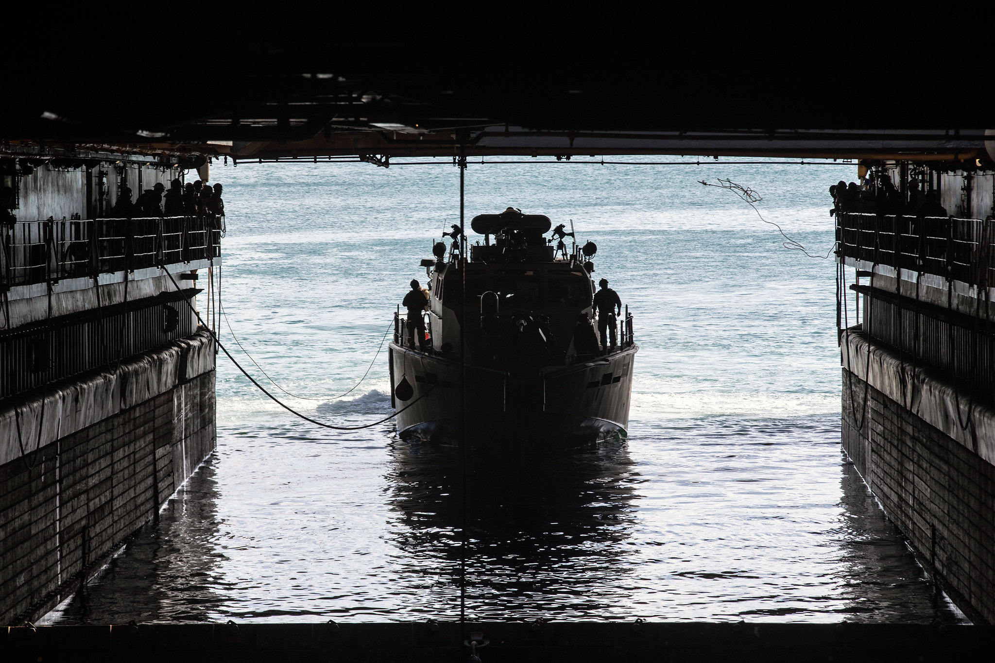 A U.S. Navy Mark VI patrol boat navigates into the well deck of dock landing ship USS Ashland (LSD 48) at Naval Base Guam, Feb. 21, 2021. (Sgt. Danny Gonzalez/Marine Corps)