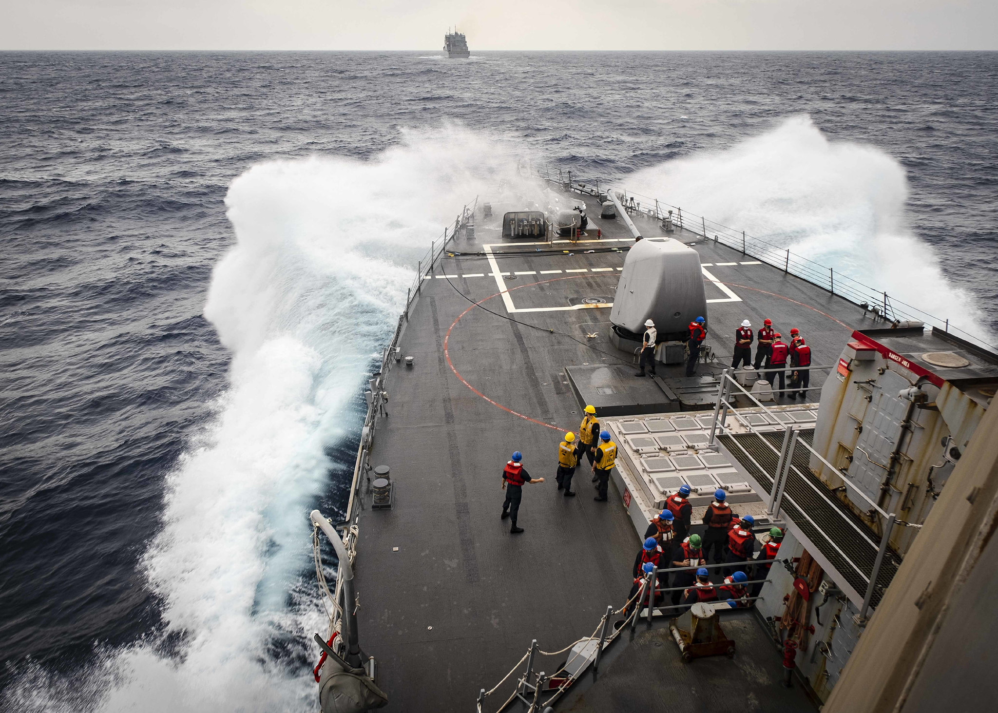 Sailors observe from the foc's'le as the Arleigh Burke-class guided-missile destroyer USS John S. McCain (DDG 56) makes its approach towards the dry cargo and ammunition ship USNS Alan Shepard (T-AKE 3) prior to a replenishment-at-sea on Oct. 22, 2020, in the South China Sea. (MC2 Markus Castaneda/Navy)