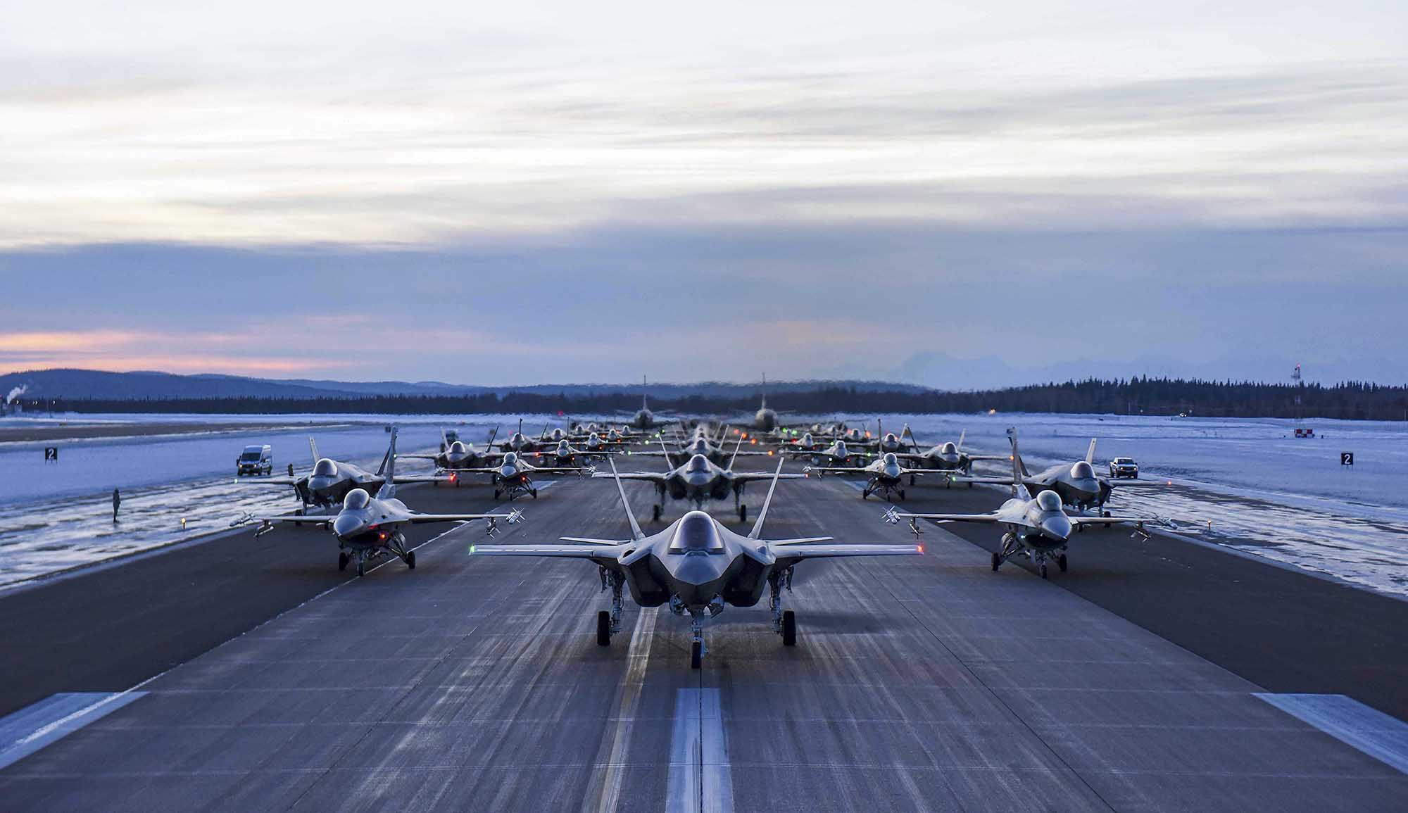 Aircraft assigned to the 354th Fighter Wing and 168th Wing park in formation on Eielson Air Force Base, Alaska, Dec. 18, 2020. Over 30 aircraft were quickly generated and prepared to launch in an effort demonstrating the readiness capabilities of the 354th Fighter Wing and the 168th Wing. (Senior Airman Keith Holcomb/Air Force)