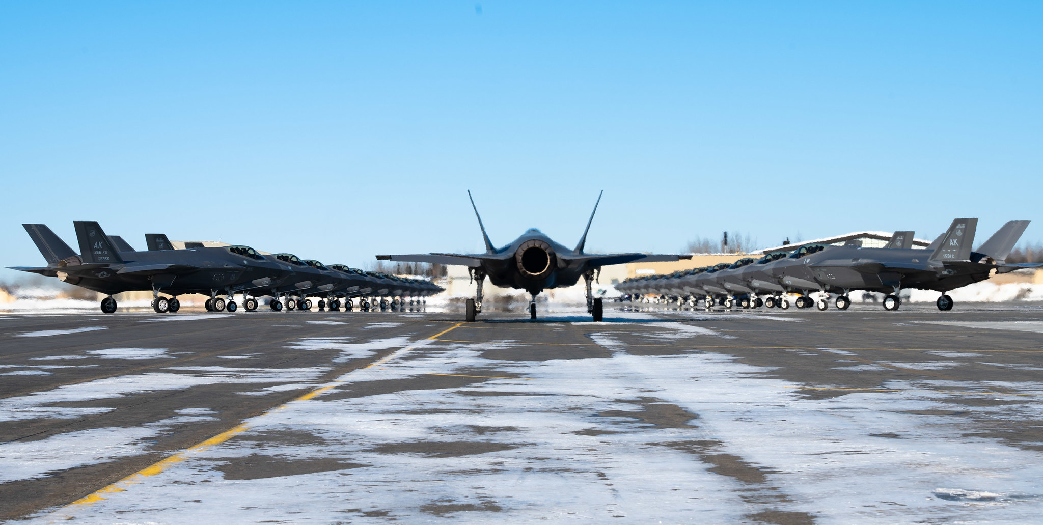 Twenty-five F-35A Lightning IIs assigned to the 354th Fighter Wing assemble on the flightline prior to taking off during Arctic Gold (AG) 21-2 at Eielson Air Force Base, Alaska, April 7, 2021. (Airman 1st Class Jose Miguel T. Tamondong/Air Force)