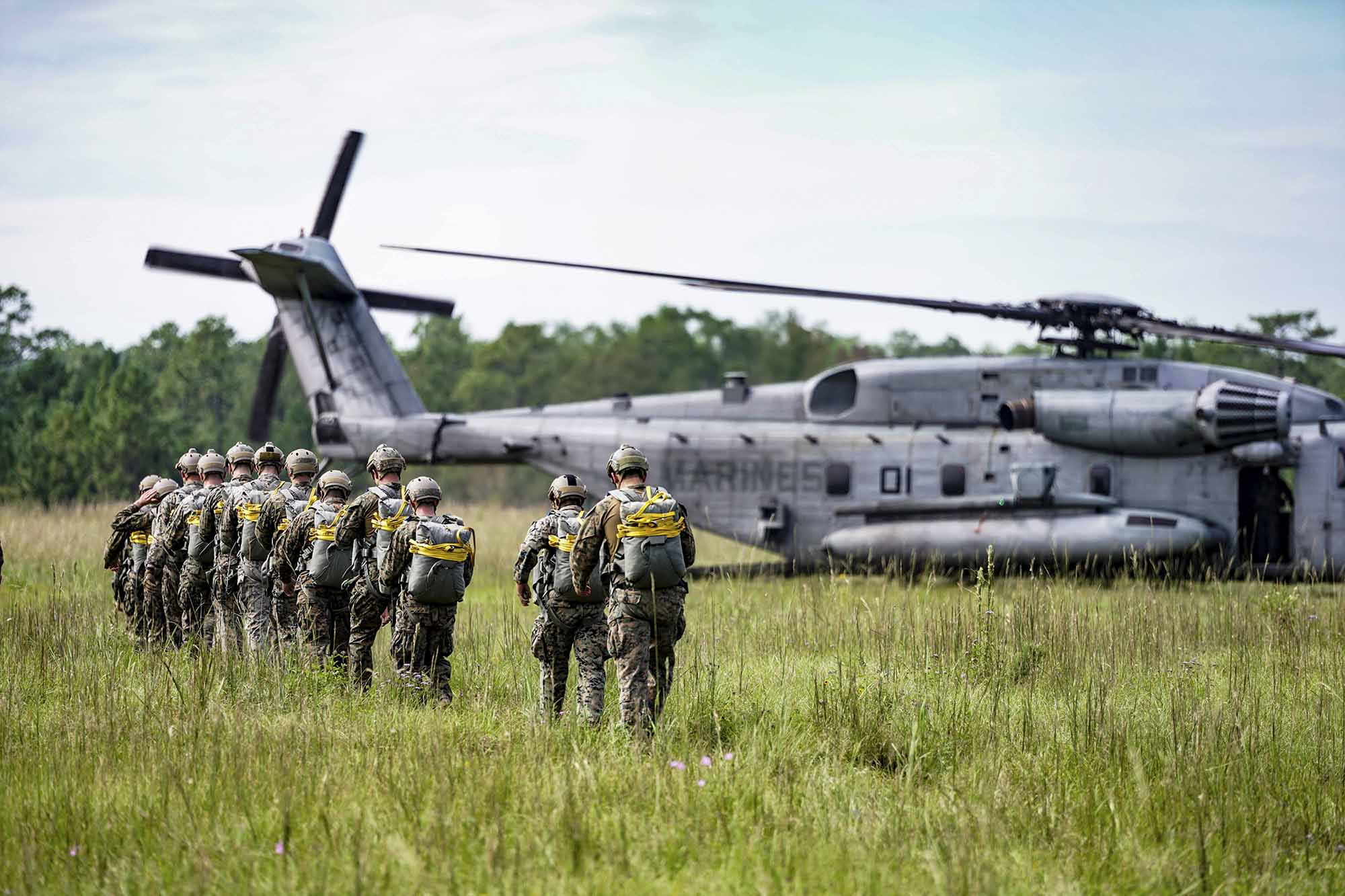 Marines with 3rd Force Reconnaissance Company, 4th Marine Division prepare to static line jump out of a CH-53 Super Stallion during an airborne operations event at Camp Shelby, Miss., Oct. 6, 2020. (Sgt. Conner Downey/Marine Corps)