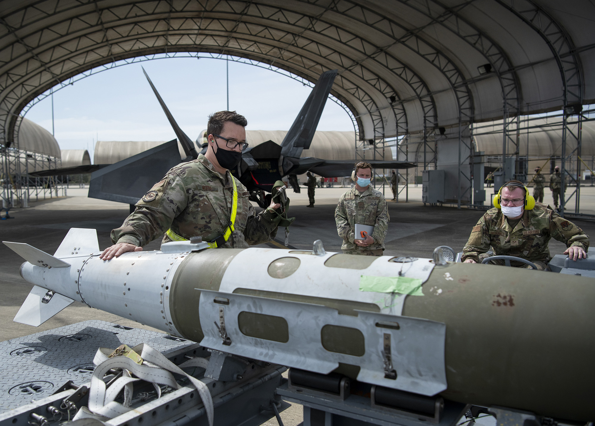 A 325th Aircraft Maintenance Squadron load crew lifts a guided bomb unit, or GBU-32, during the unit's weapons load competition March 23, 2021, at Eglin Air Force Base, Fla. (Samuel King Jr./Air Force)