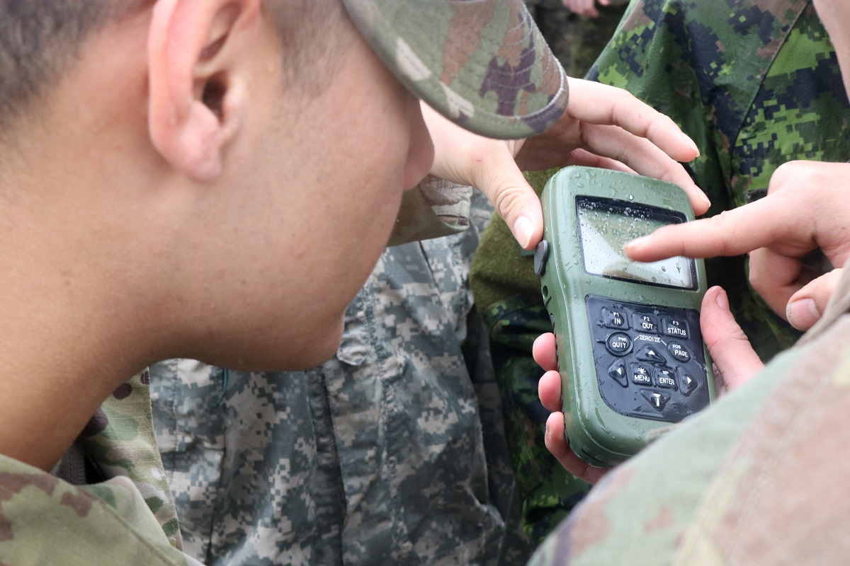Soldiers with the 804th Transportation Detachment, Tacoma, Washington, the 180th Transportation Company, Muskegon, Michigan, and 3 Canadian Division Support Group Det Wainwright practice using GPS receiver during Exercise Maple Resolve 19-01 on 3rd Canadian Division Support Base Det Wainwright, Wednesday, May 15, 2019. Maple Resolve is Canada's annual brigade-level validation exercise for the Canadian Army's High Readiness Brigade and is designed to develop partnership among forces and increase interoperability. (U.S. Army Reserve photo by Sgt. Christopher Osburn)