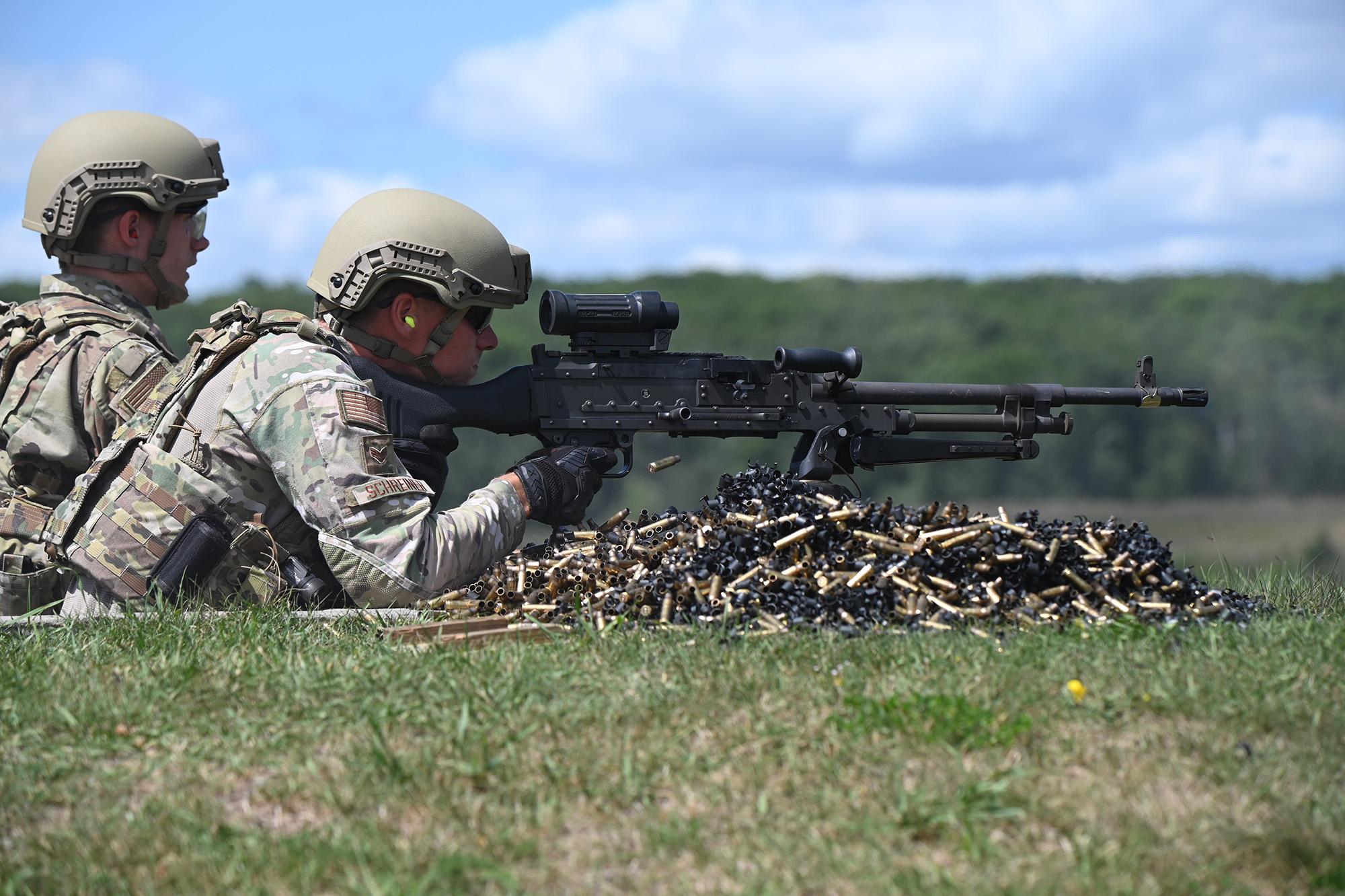 Senior Airman Brian Schreiner, 119th Security Forces Squadron, fires an M240 machine gun at firing-range targets at Camp Ripley Training Center, Minn., Aug. 3, 2020. (Chief Master Sgt. David H. Lipp/Air National Guard)