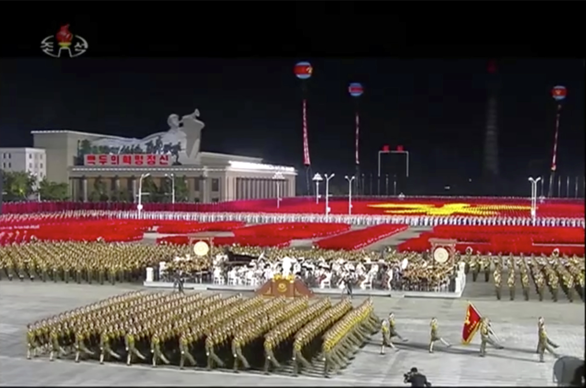 In this image made from video broadcasted by North Korea's KRT on Oct. 10, 2020, a military parade is held during a ceremony to celebrate the 75th anniversary of the country's ruling party in Pyongyang. (KRT via AP)