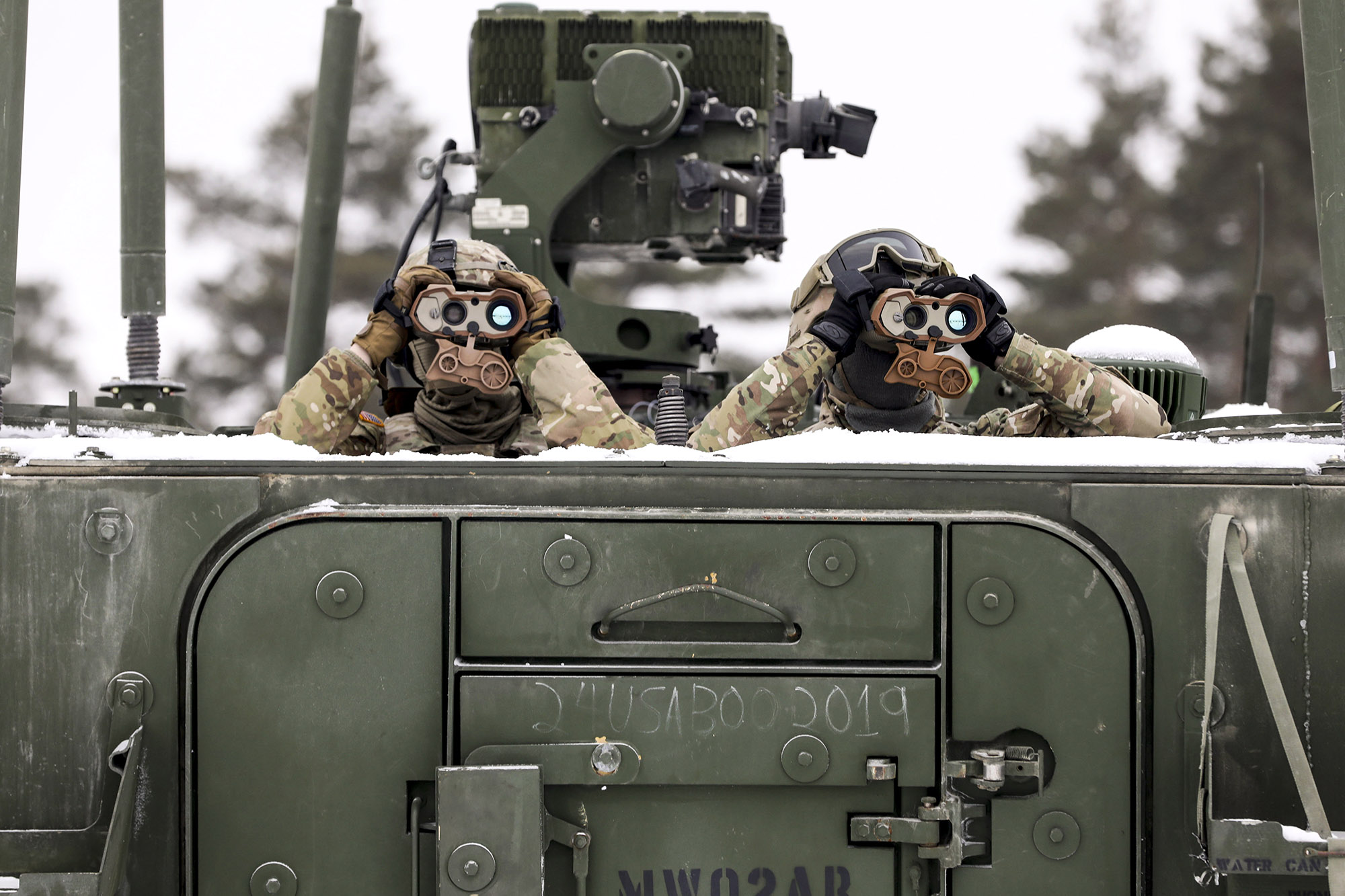 Soldiers from 1st Squadron, 2d Cavalry Regiment, enhanced Forward Presence Battle Group Poland, keep watch on targets during a joint combat live fire of the Gepard Air Defense System Feb. 2, 2021, at Bemowo Piskie Training Area, Poland. (Staff Sgt. Elizabeth O. Bryson/Army)