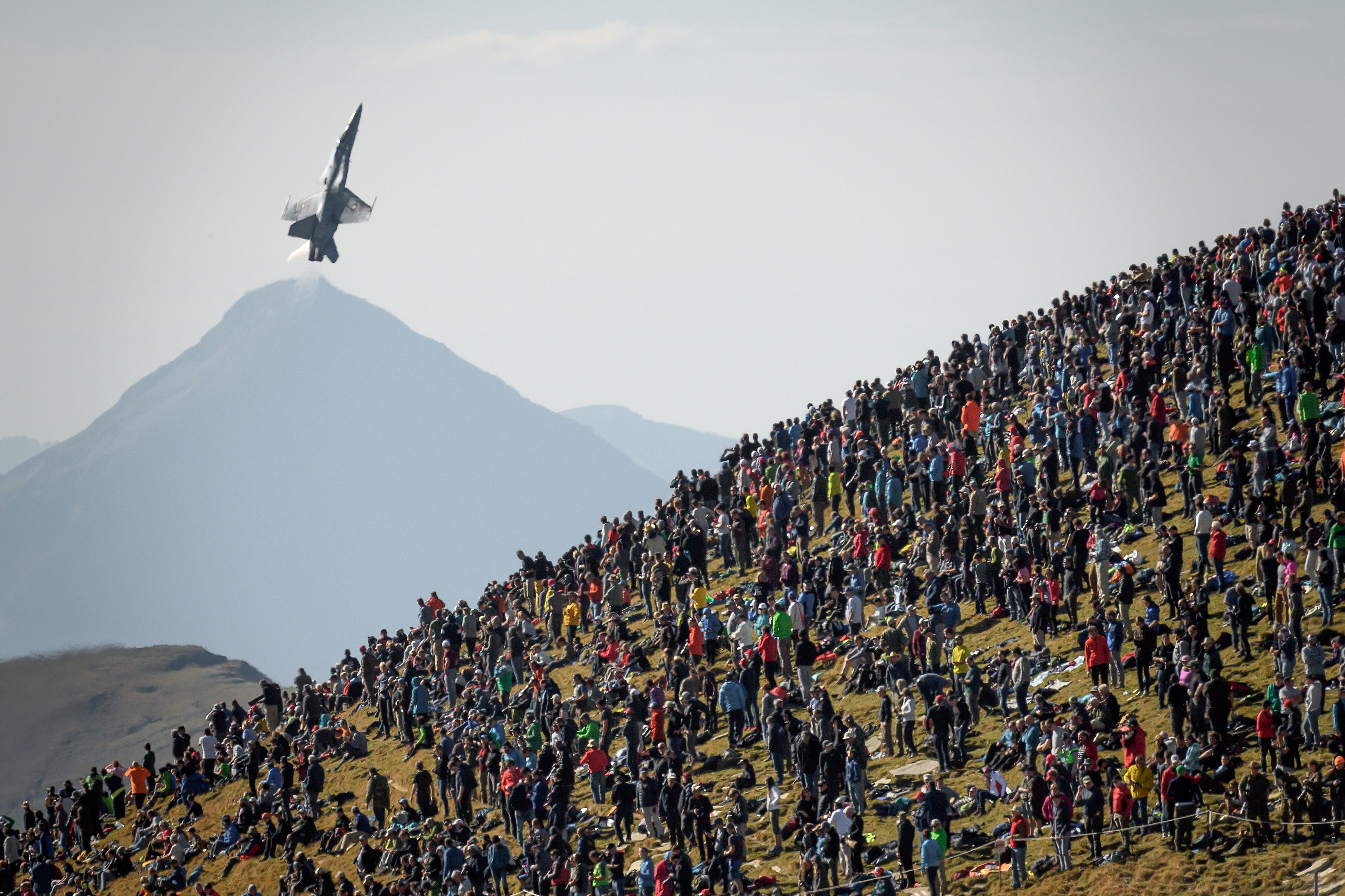 An F/A-18 Hornet flies over spectators during the annual live-fire event of the Swiss Air Force at the Axalp, over Brienz in the Bernese Alps, on Oct. 10, 2018. The planes are up for replacement under the Air 2030 program. (Fabrice Coffrinie/AFP via Getty Images)