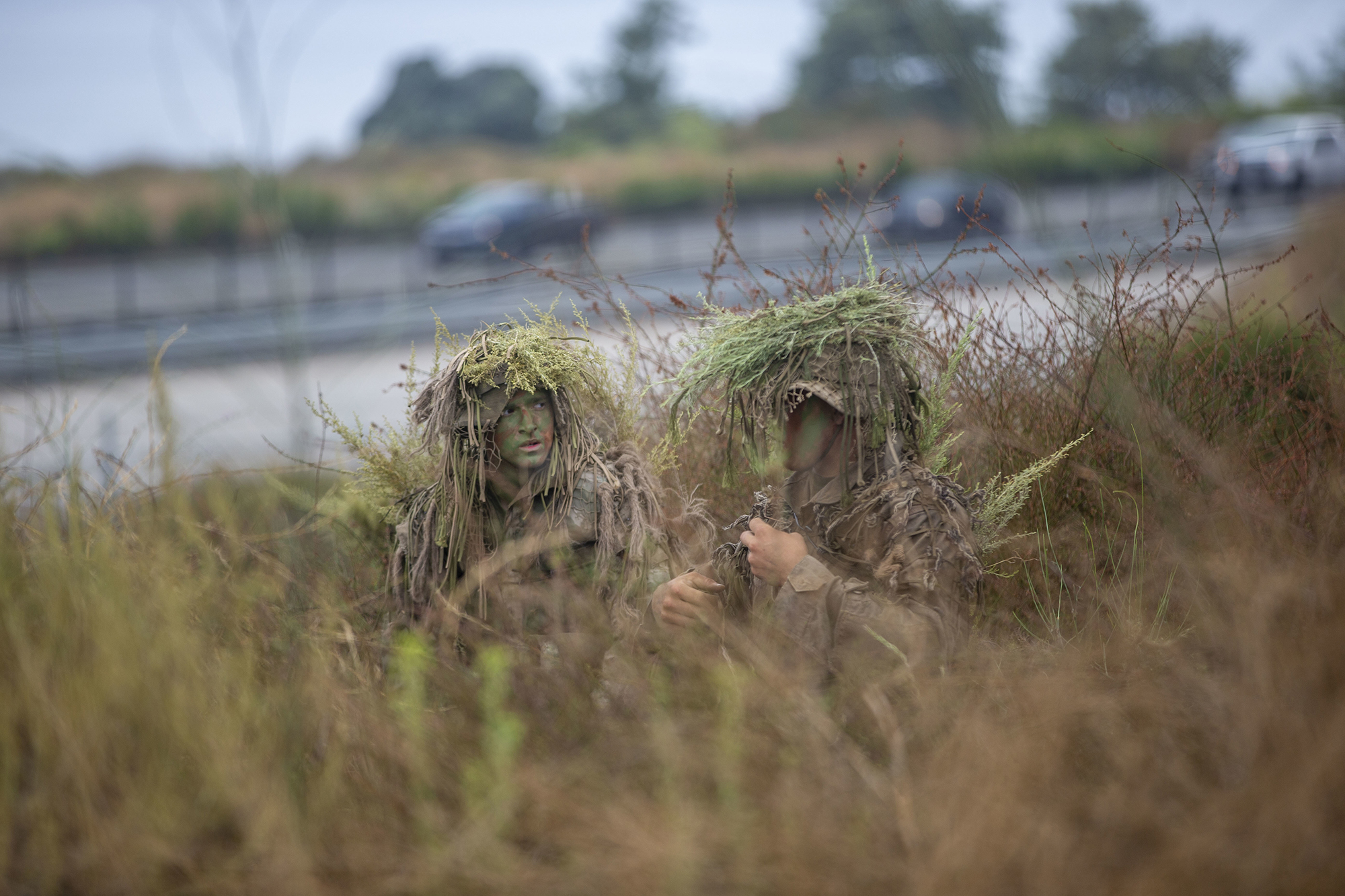 Marines with the Scout Sniper Course, Reconnaissance Training Company, Advanced Infantry Training Battalion, School of Infantry - West, work to conceal themselves during an exercise in the Romeo Training Area on Marine Corps Base Camp Pendleton, Calif., July 27, 2020. (Lance Cpl. Drake Nickels/Marine Corps)