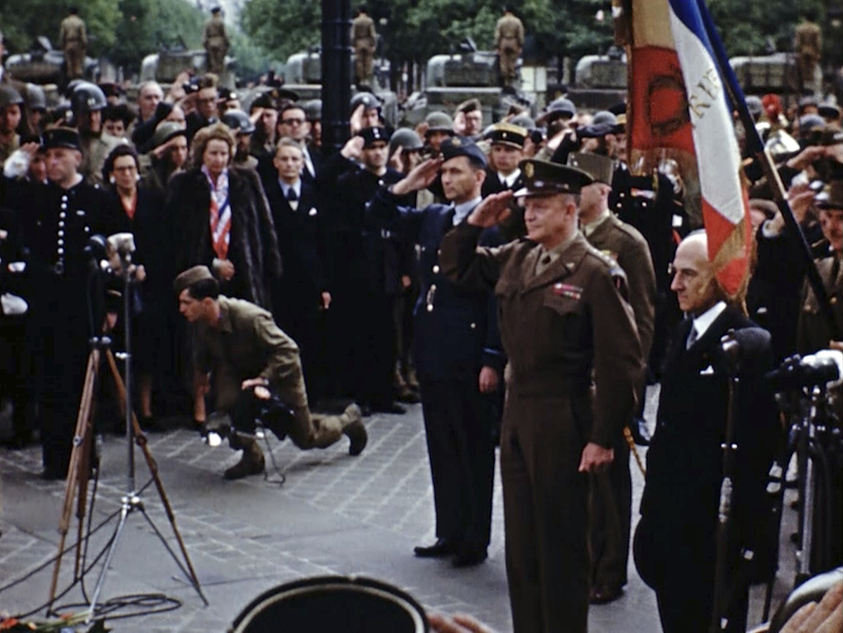 U.S. Gen. Dwight D. Eisenhower attends a ceremony at the Tomb of the Unknown Solider in Paris. Seventy-five years later, surprising color images of the D-Day invasion and aftermath bring an immediacy to wartime memories. They were filmed by Hollywood director George Stevens and rediscovered years after his death. (War Footage From the George Stevens Collection at the Library of Congress via AP)