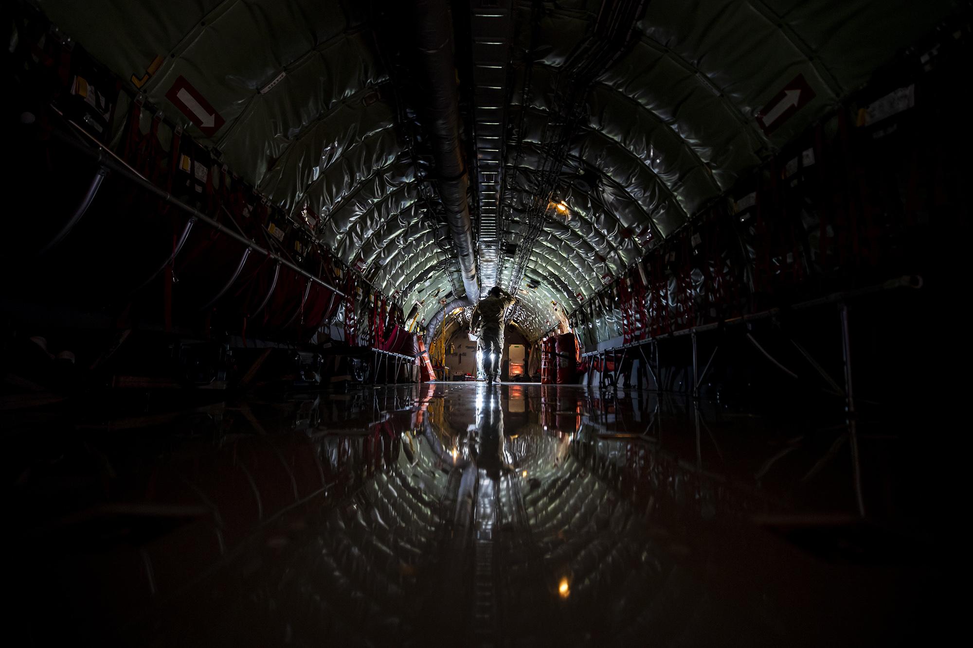 Tech. Sgt. Vince Stokes, 141st Air Refueling Squadron book operator, walks through a KC-135R Stratotanker at Fairchild Air Force Base, Wash., May 6, 2021. (Master Sgt. Matt Hecht/Air National Guard)