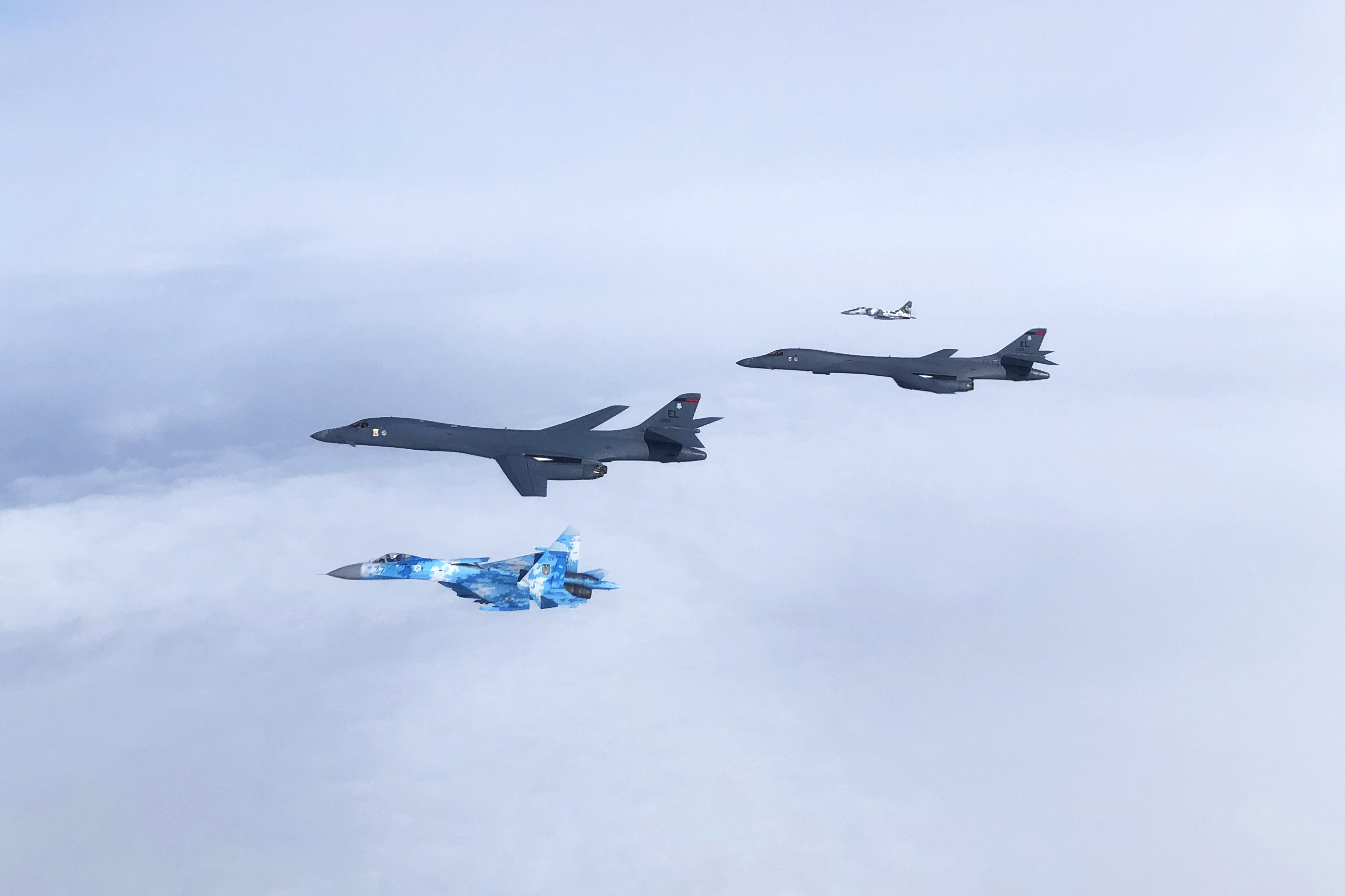 A Ukrainian Su-27 Flanker and MiG-29 Fulcrum escort two B-1B Lancers during a training mission for Bomber Task Force Europe on May 29, 2020, in the Black Sea region. (Courtesy of the Ukrainian Air Force)