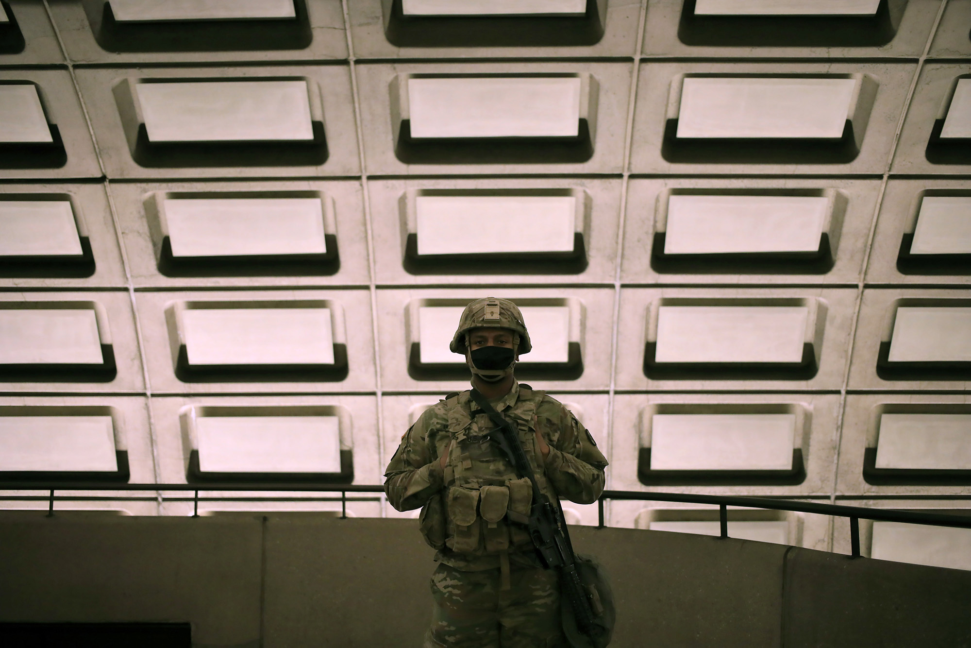 North Carolina Army National Guard soldiers patrol the Rosslyn Subway Station on the morning of the dedication ceremony on January 20, 2021 in Arlington, Virginia. (Luke Sharrett / Getty Images)
