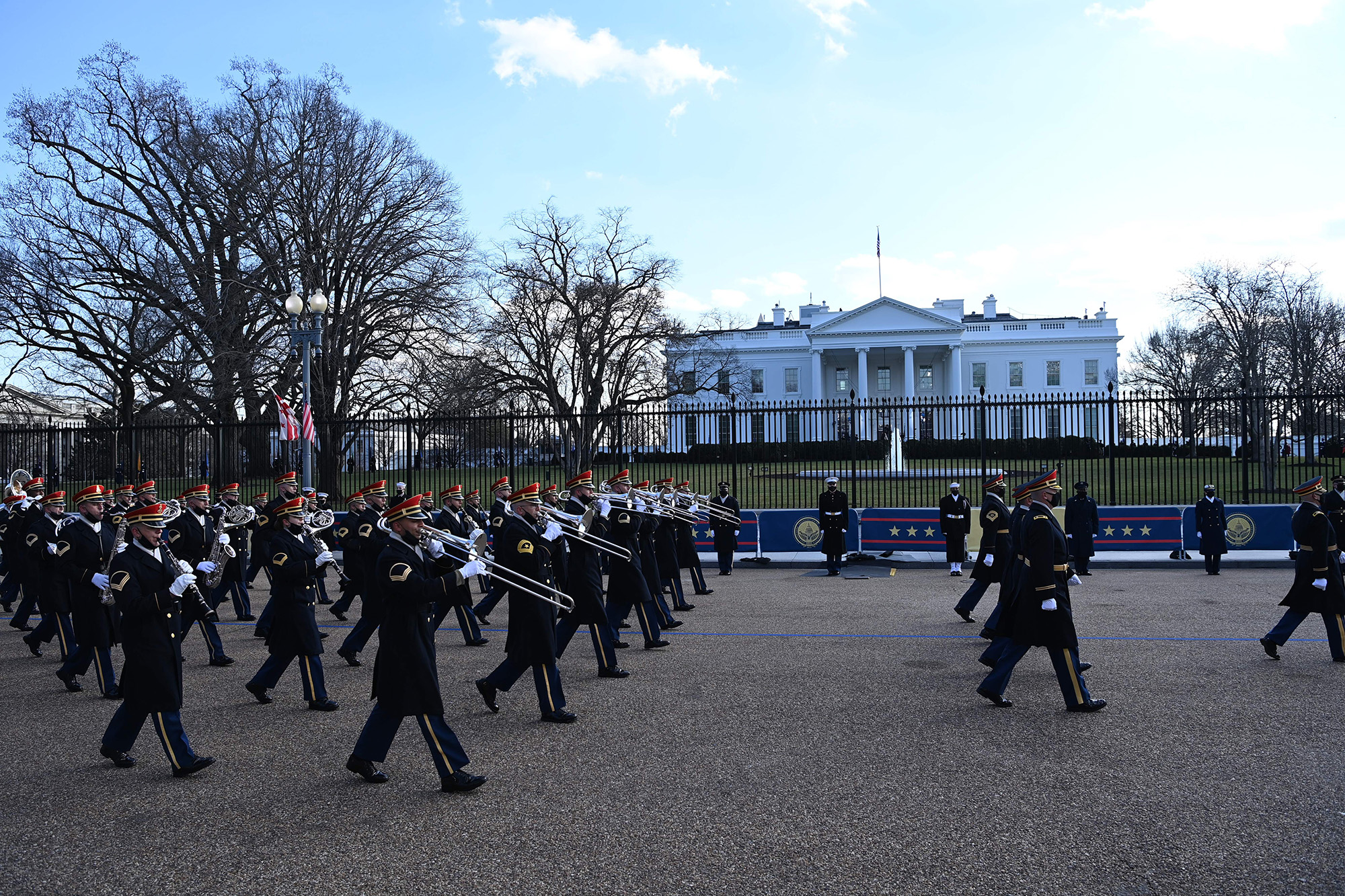 A military band parades on the street near the White House after President Joe Biden and Vice President Kamala Harris were sworn in at the Capitol on Jan. 20, 2021, in Washington. (Mandel Ngan/AFP via Getty Images)
