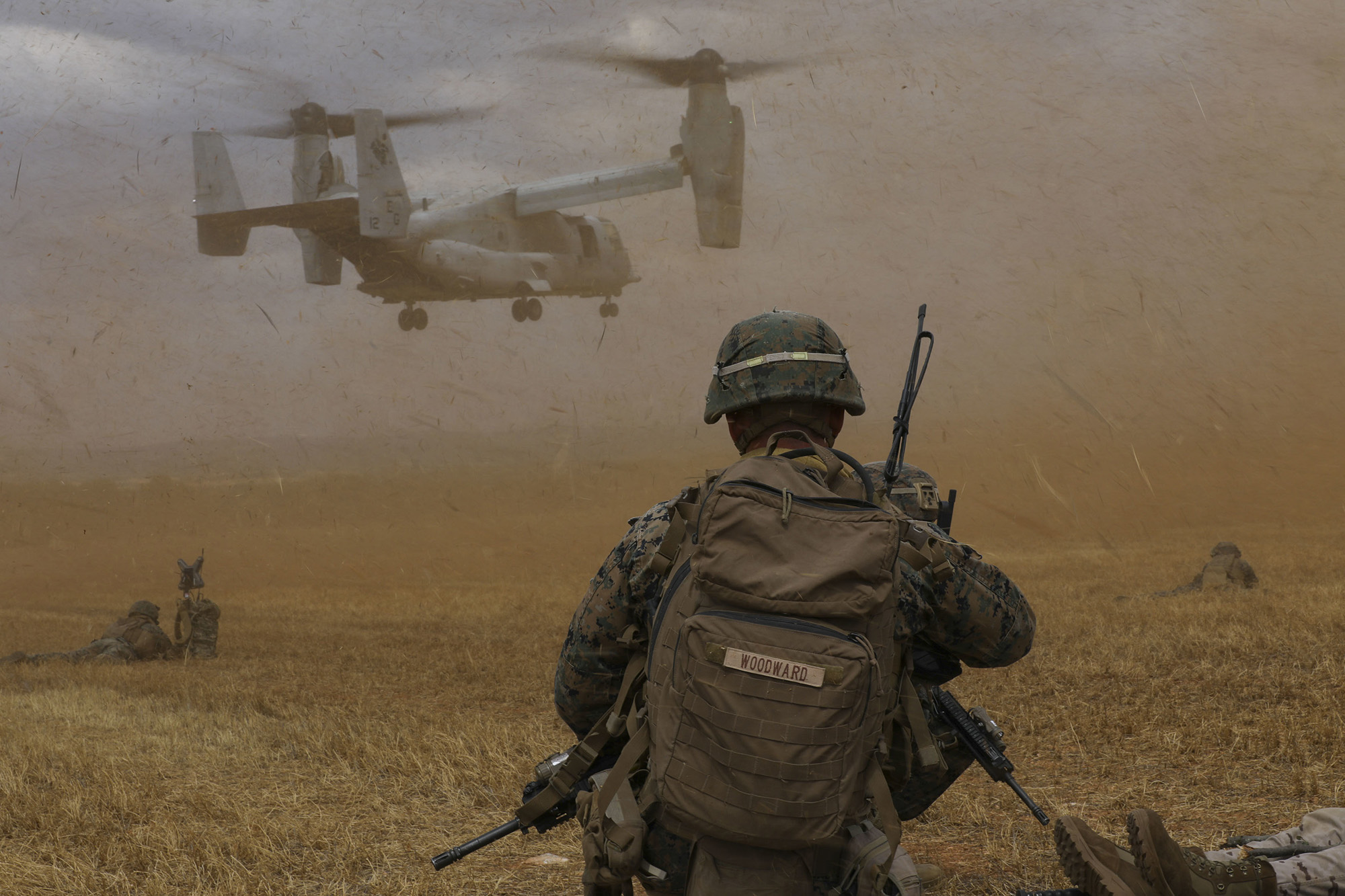 A U.S. Marine with Special Purpose Marine Air-Ground Task Force-Crisis Response-Africa 20.2, Marine Forces Europe and Africa, watches an MV-22B Osprey land at a landing zone during a tactical recovery of aircraft and personnel in Albacete, Spain, July 9, 2020. (Cpl. Antonio F. Garcia/Marine Corps)