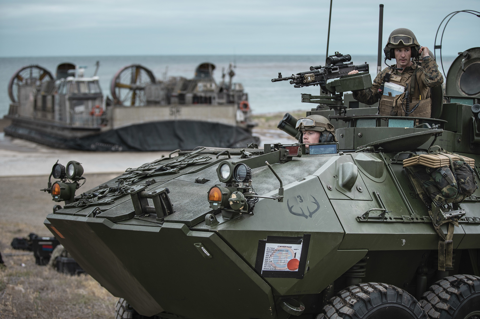 Marines offload a light armored vehicle during an expeditionary advance base exercise at San Clemente Island, Calif., May 15, 2021. (Sgt. Alexis Flores/Marine Corps)