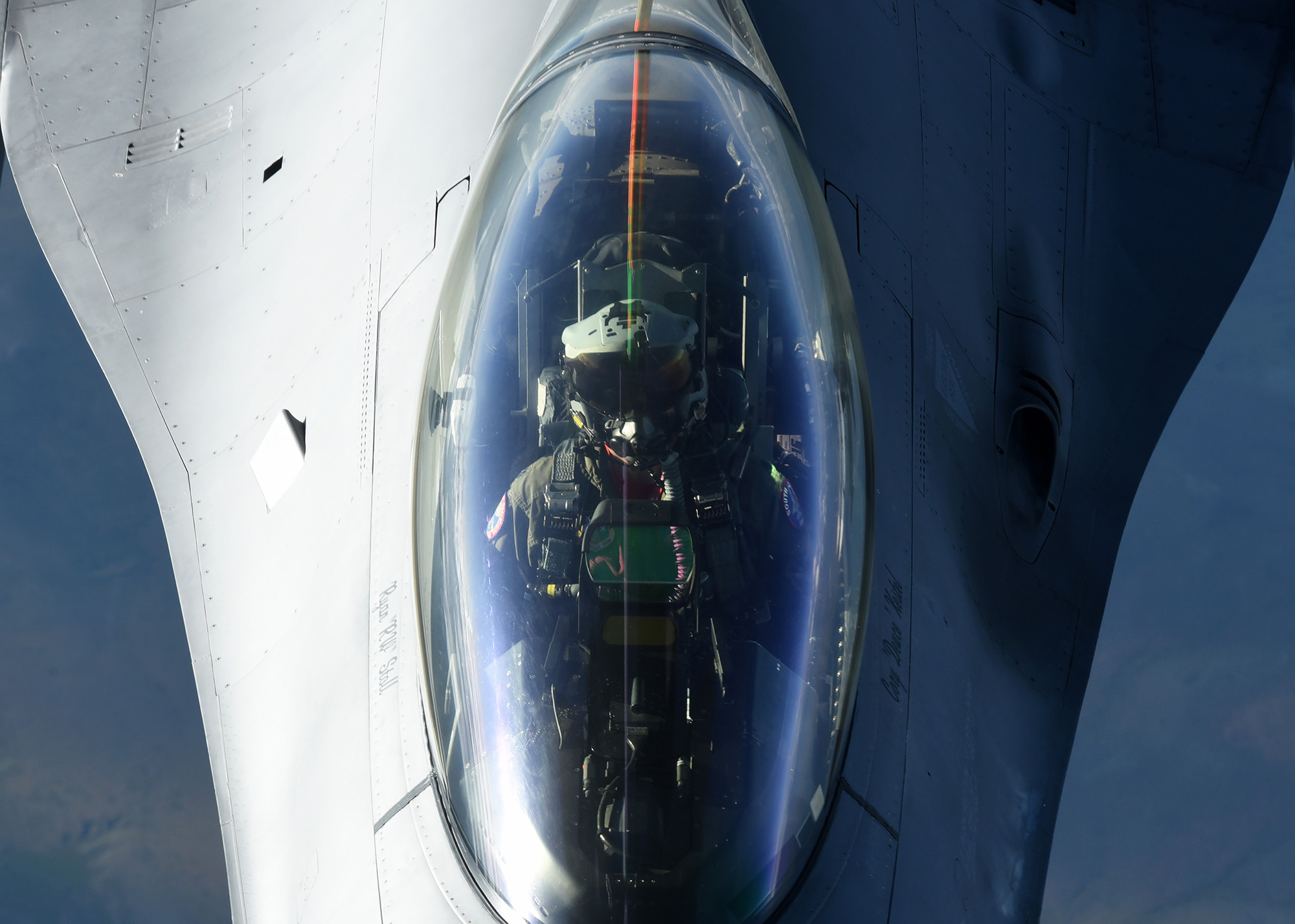 An Air Force F-16 Fighting Falcon receives fuel from a KC-10 Extender on July 3, 2020. The F-16, and other military aircraft, flew over Mount Rushmore in South Dakota during a