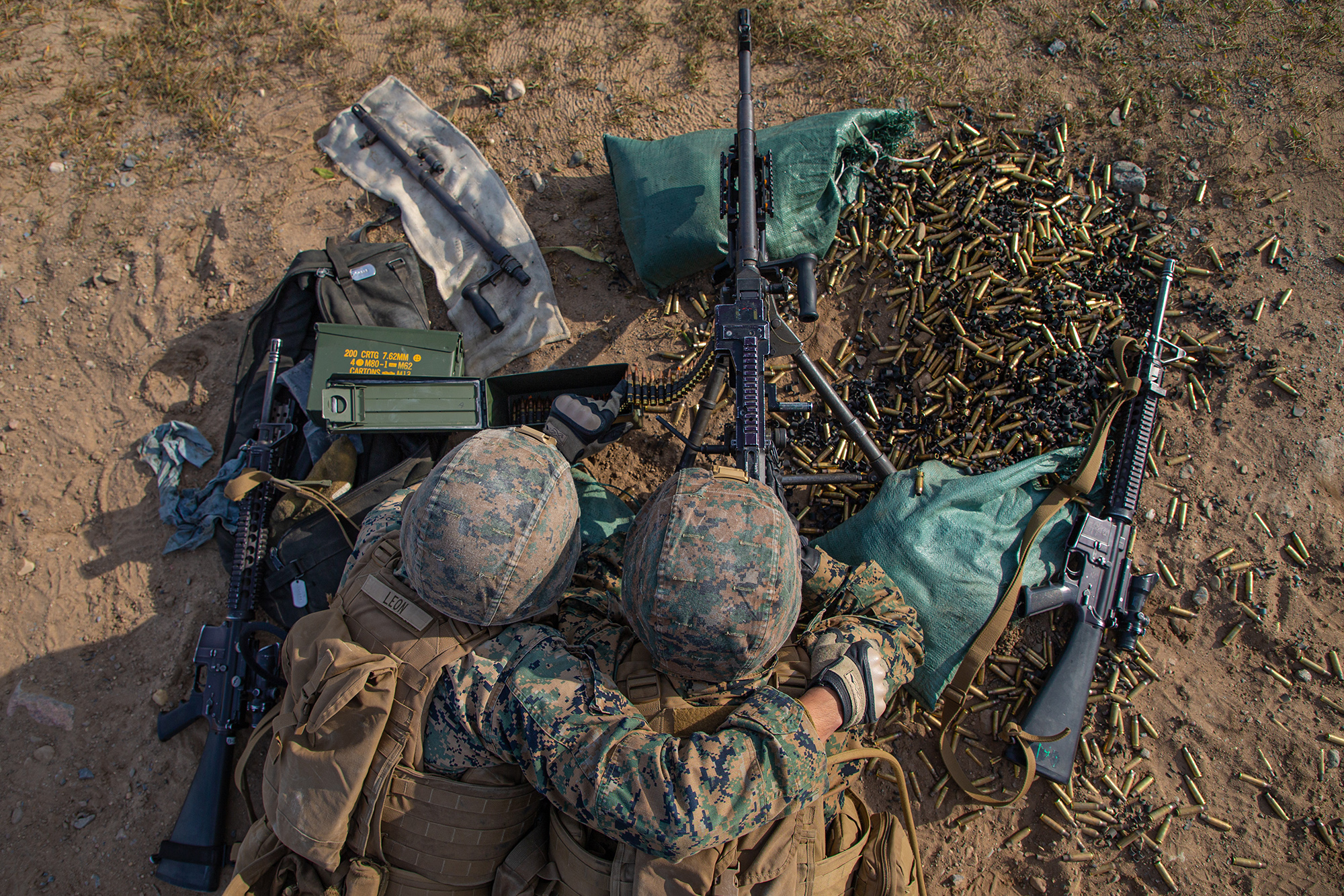 Marines fire an M240B machine gun during a team defense range as part of MEFEX 21.1 at Fort Drum, N.Y., Nov. 6, 2020. (Lance Cpl. Scott Jenkins/Marine Corps)