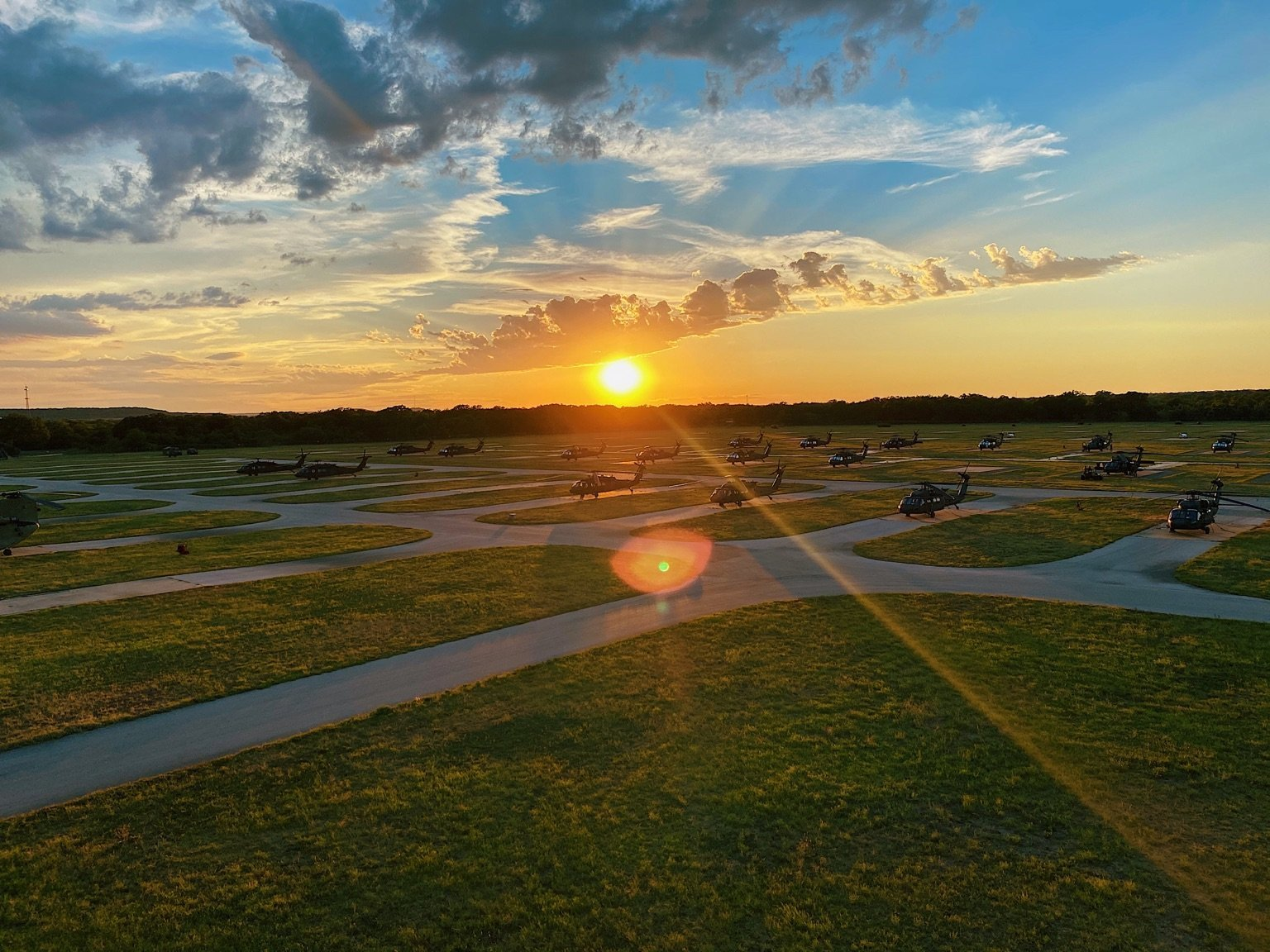 The sun sets behind an airfield at the 28th Expeditionary Combat Aviation Brigade's mobilization station at Fort Hood, Texas. (Staff Sgt. Breanna Chase/Army)