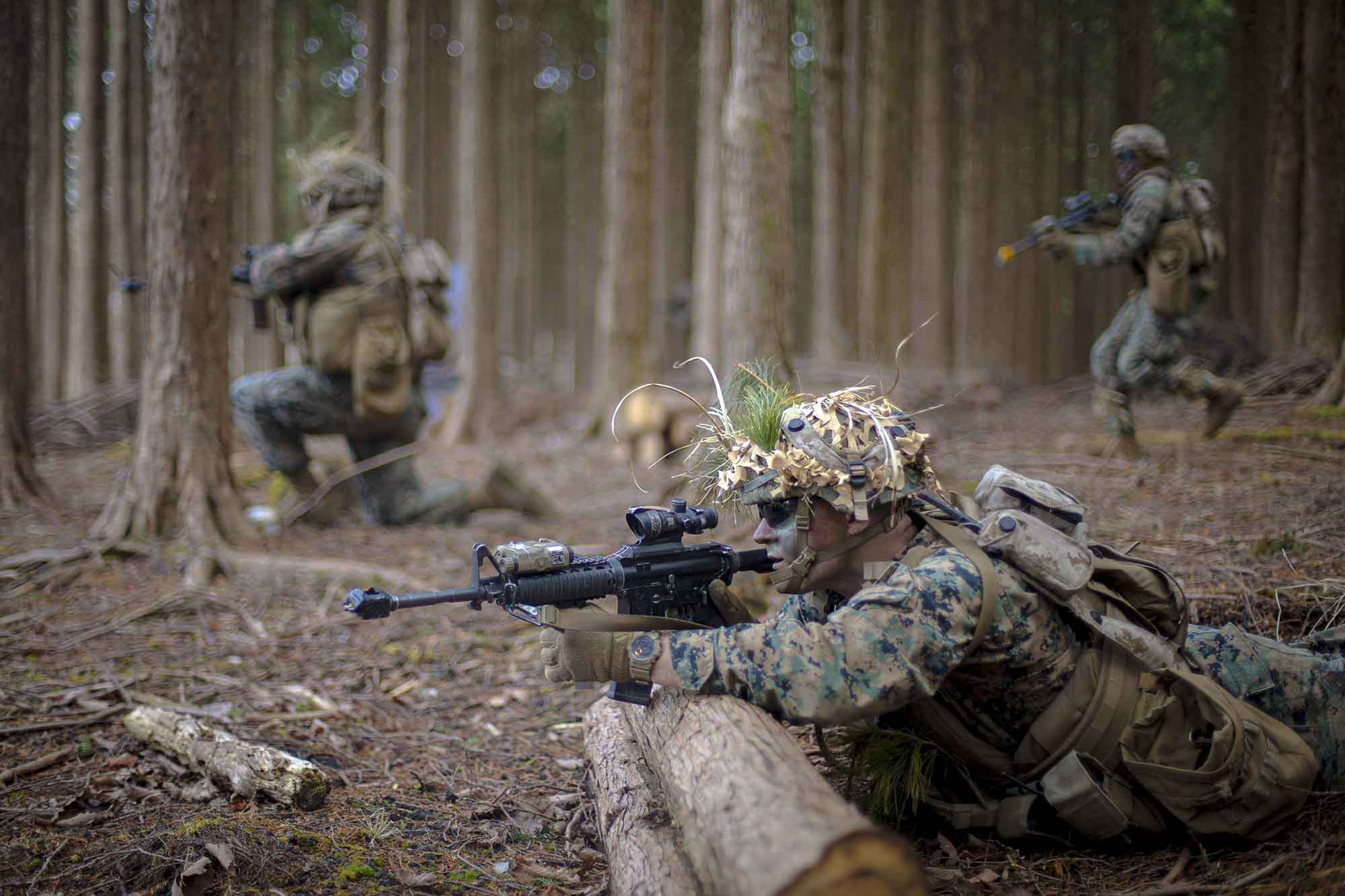 Marines advance during a force-on-force exercise at Combined Arms Training Center Camp Fuji, Japan, March 4, 2021. (Cpl. Cody Rowe/Marine Corps)