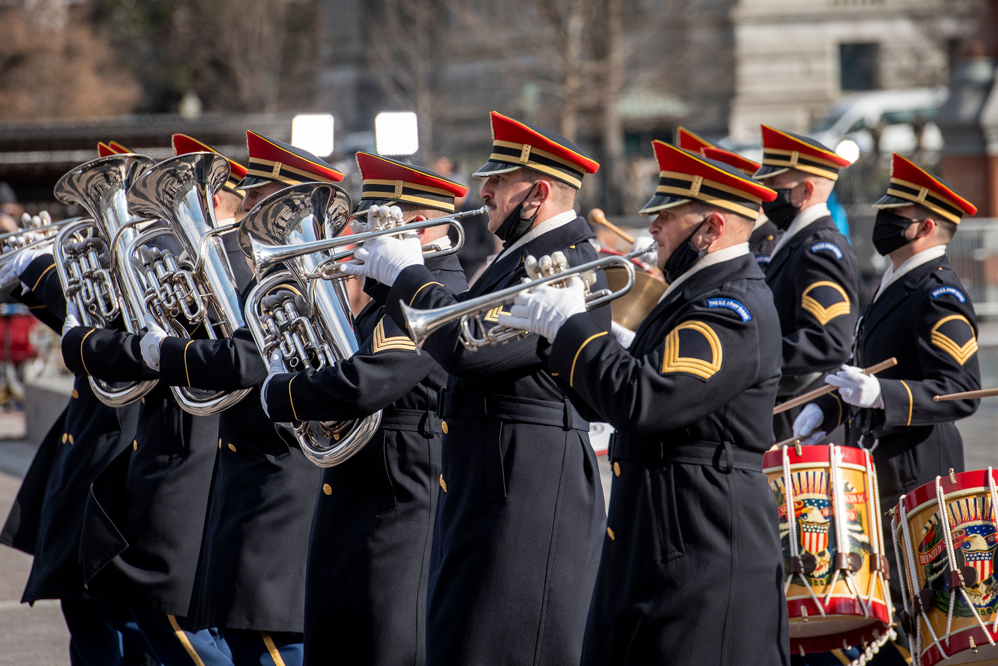 Military bands parade past President Joe Biden and Vice President Kamala Harris as they prepare to depart the Capitol following their taking the Oath of Office as the 46th president and 49th vice president of the United States in Washington on Jan. 20, 2021. (Rod Lamkey/Pool, AFP via Getty Images)
