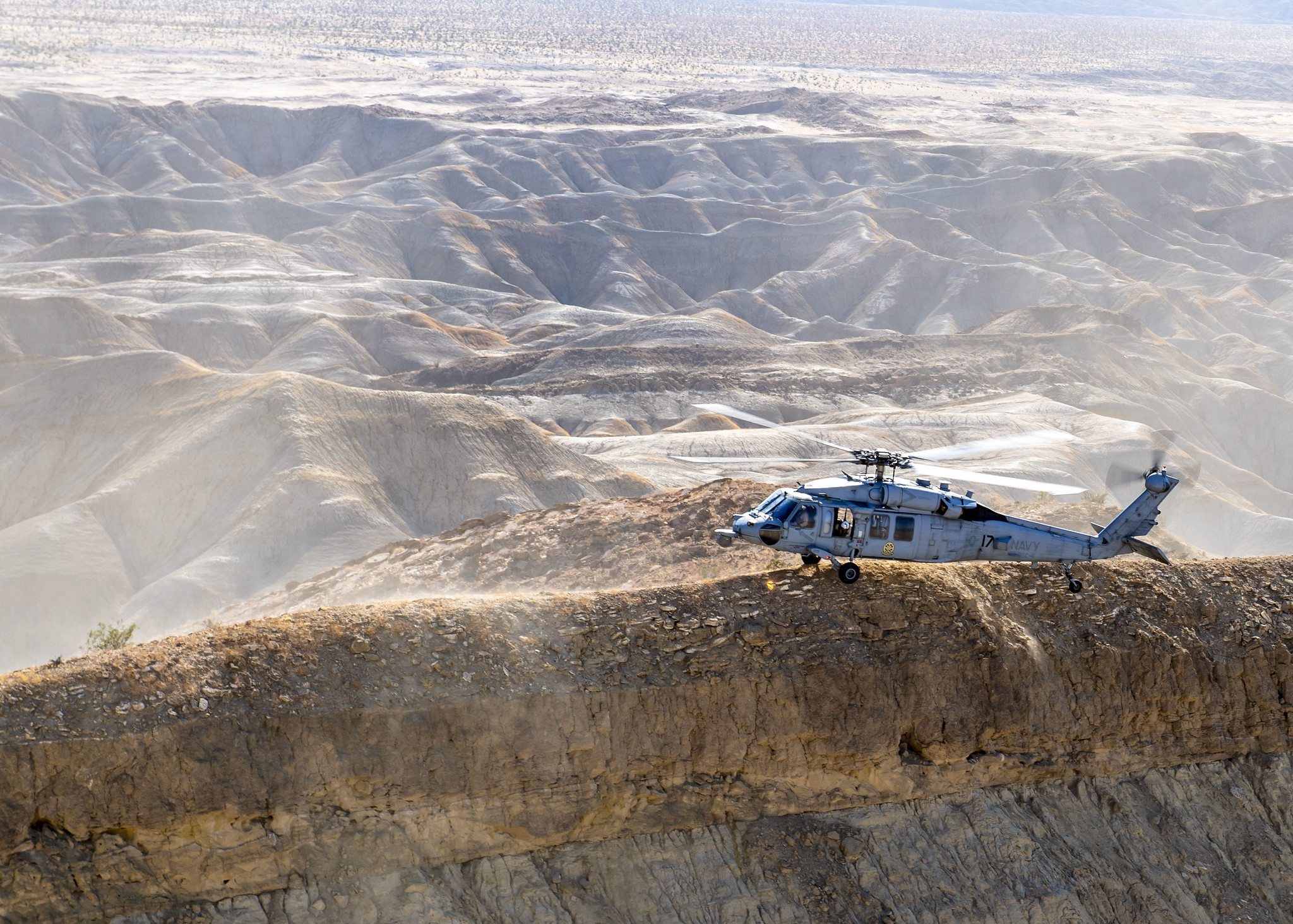 An MH-60S Sea Hawk helicopter stationed in San Diego practices terrain flight tactical landings on Oct. 1, 2020, during Helicopter Advanced Readiness Program (HARP) training at Naval Air Facility El Centro, Calif. (MC2 Ryan M. Breeden/Navy)