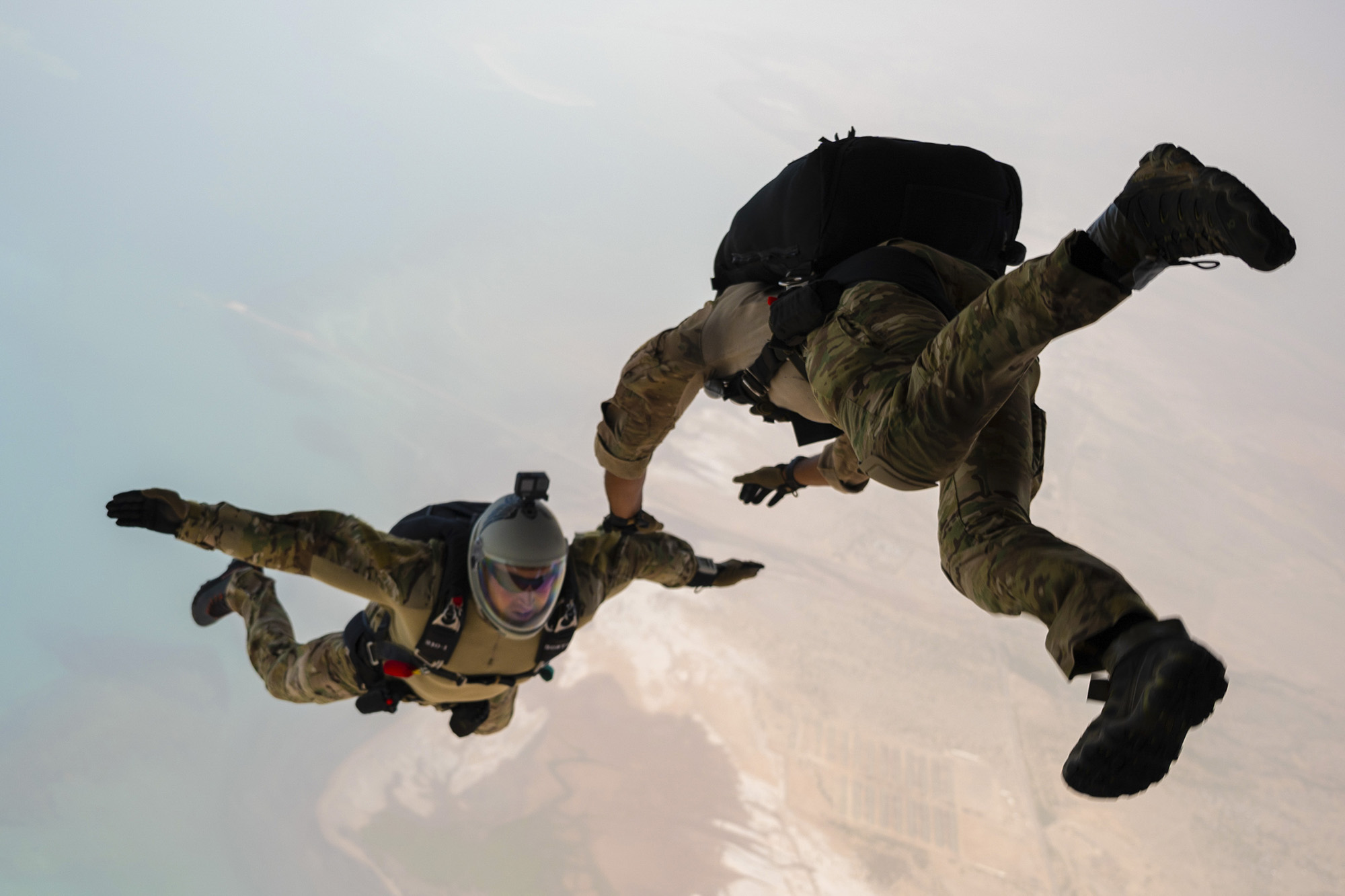 U.S. Air Force special warfare airmen assigned to the 82nd Expeditionary Rescue Squadron perform static line and military free fall jumps from a KC-130J over Djibouti, June 21, 2021. (Tech. Sgt. Daniel Asselta/Air Force)