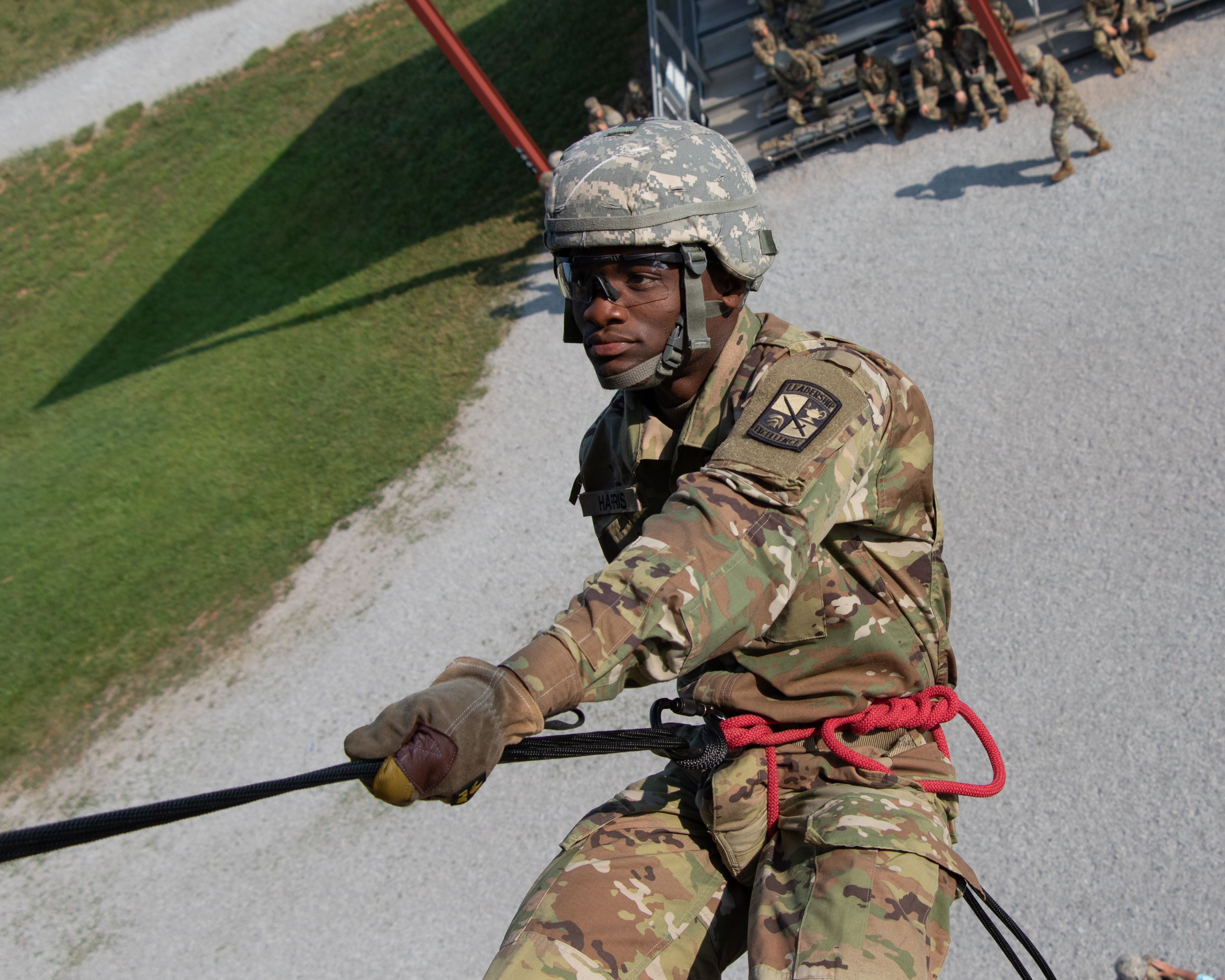 """A cadet of 6th Regiment, Advanced Camp, stands in an """"L"""" position as he prepares to rappel down the side of a tower at Fort Knox, Ky., July 3. (Griffin Amrein/Army)"""