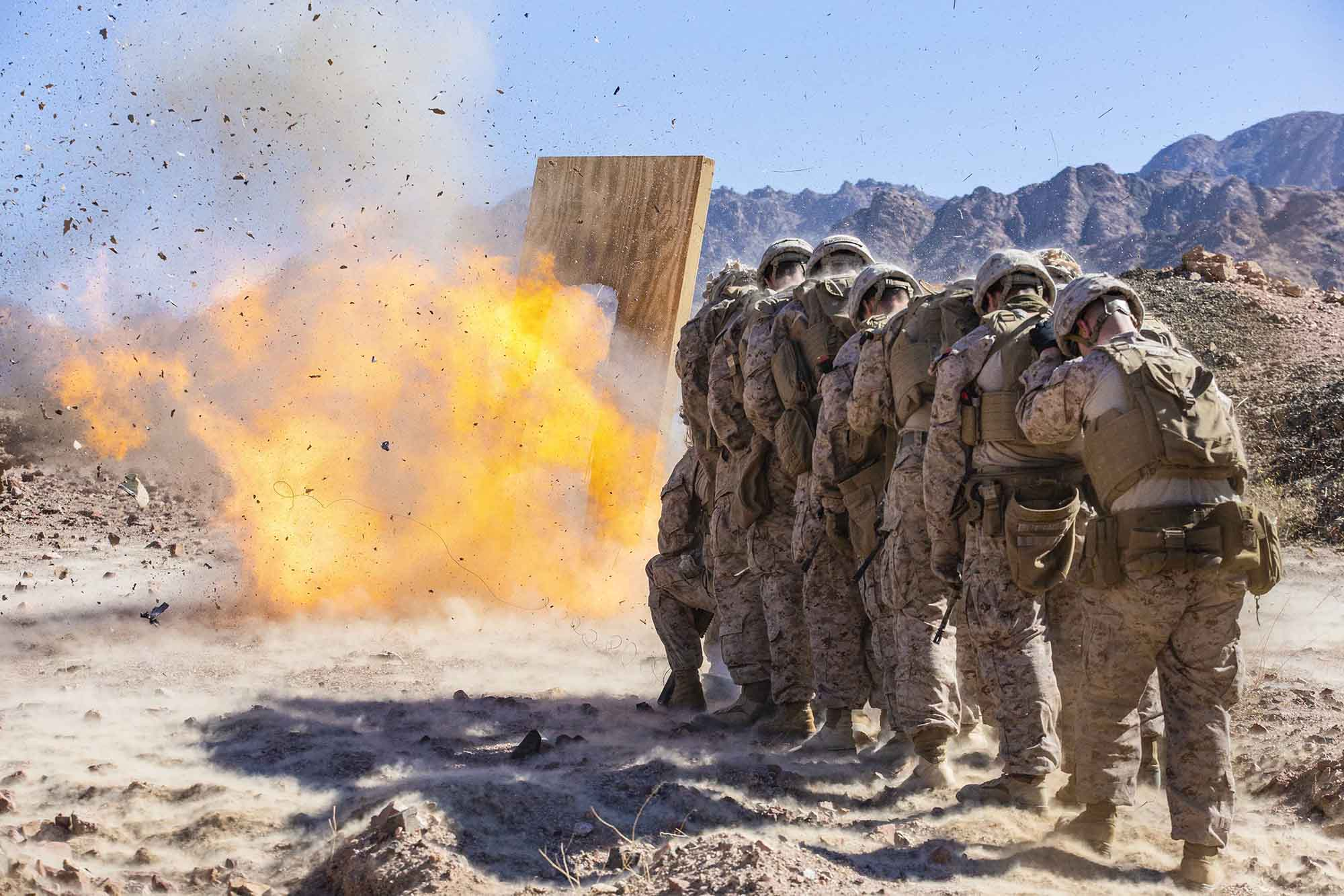 Marines assigned to Special Purpose Marine Air-Ground Task Force-Crisis Response-Central Command breach a door during a demolition range in Jordan, March 6, 2021. (Lance Cpl. Benjamin Aulick/Marine Corps)