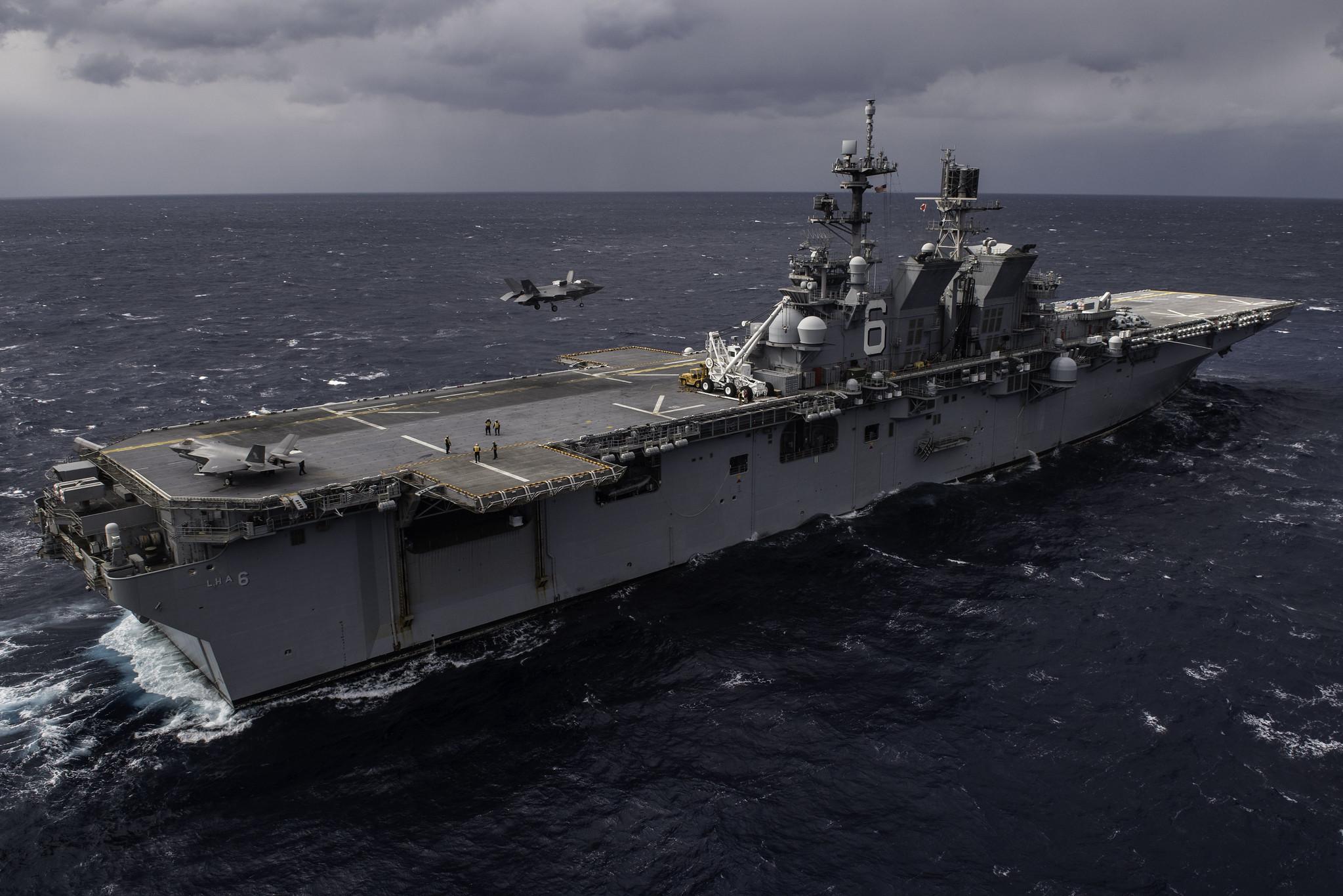 An F-35B Lightning II lands on the flight deck o the forward-deployed amphibious assault ship USS America (LHA 6) on Jan. 9, 2020, in the Philippine Sea. (Mass Communication Specialist Seaman Matthew Cavenaile/Navy)
