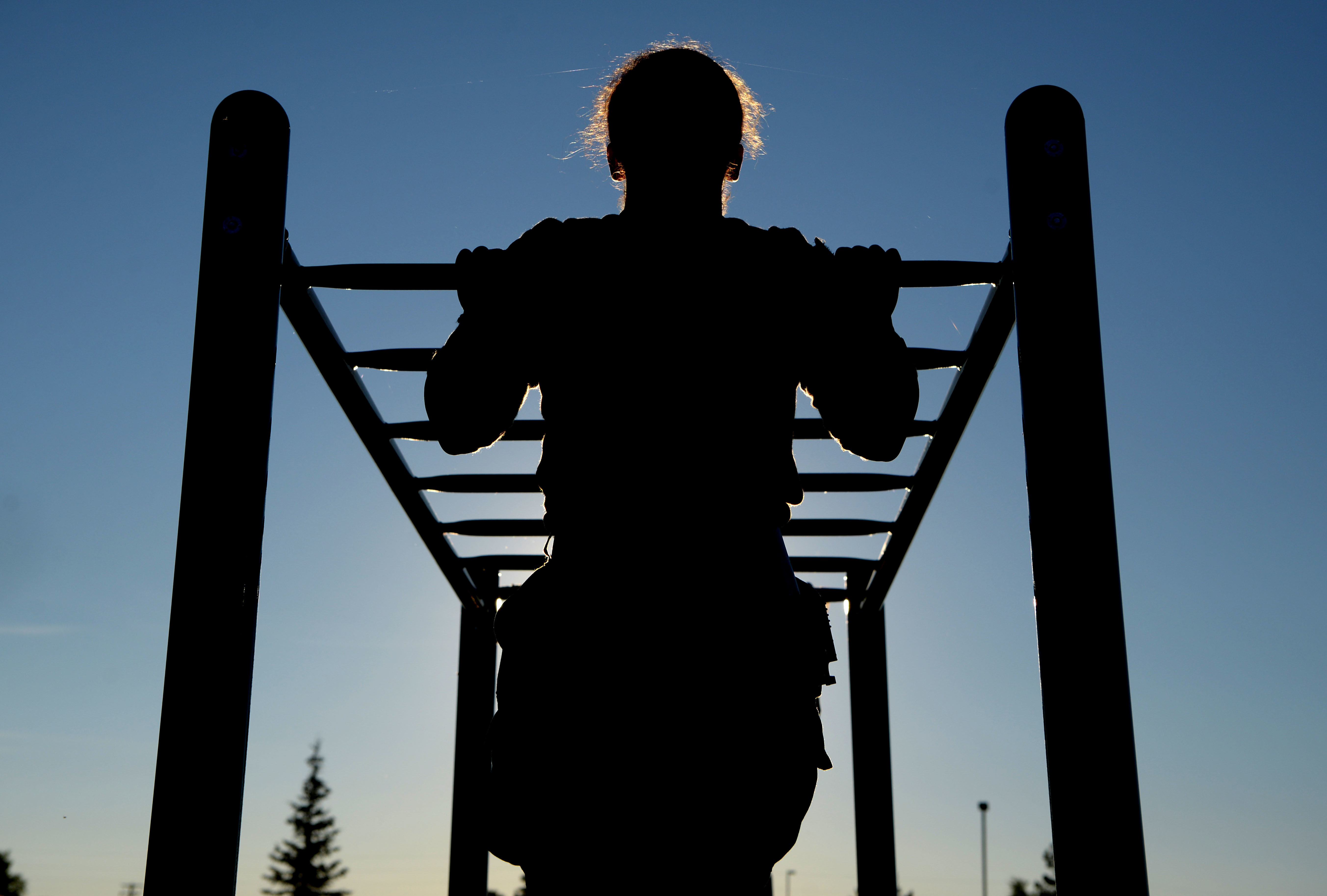 Airman 1st Class Alexandranell Soto, 354th Security Forces Squadron response force leader, completes a pullup during a special weapons and tactics physical training test at Eielson Air Force Base, Alaska, June 23. (Senior Airman Beaux Hebert/Air Fprce)
