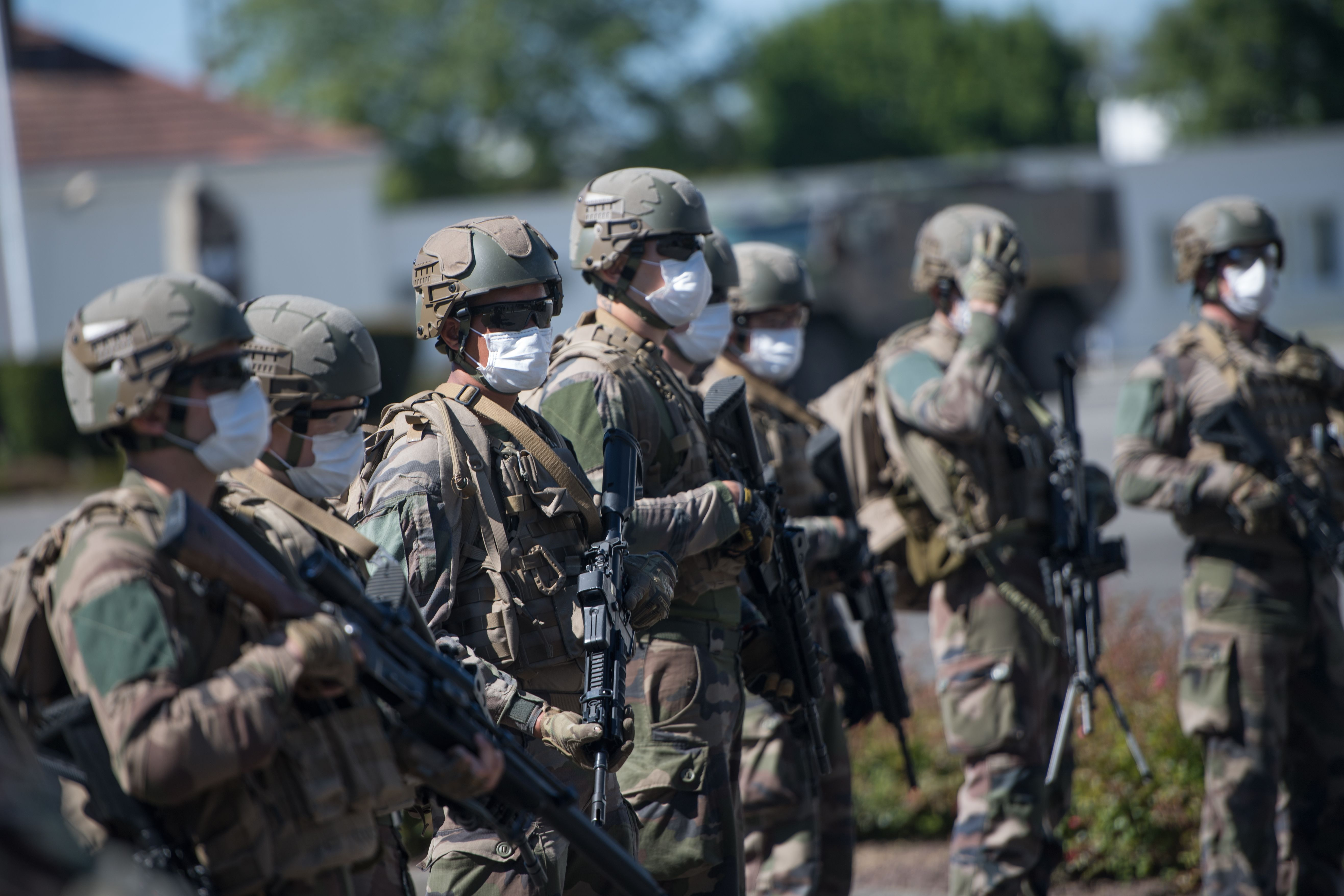 Soldiers of the 3d RIMA listen to the French armed forces minister in Vannes, western France, on May 18, 2020, after France eased lockdown measures to curb the spread of the COVID-19 pandemic. (Loic Venance/AFP via Getty Images)