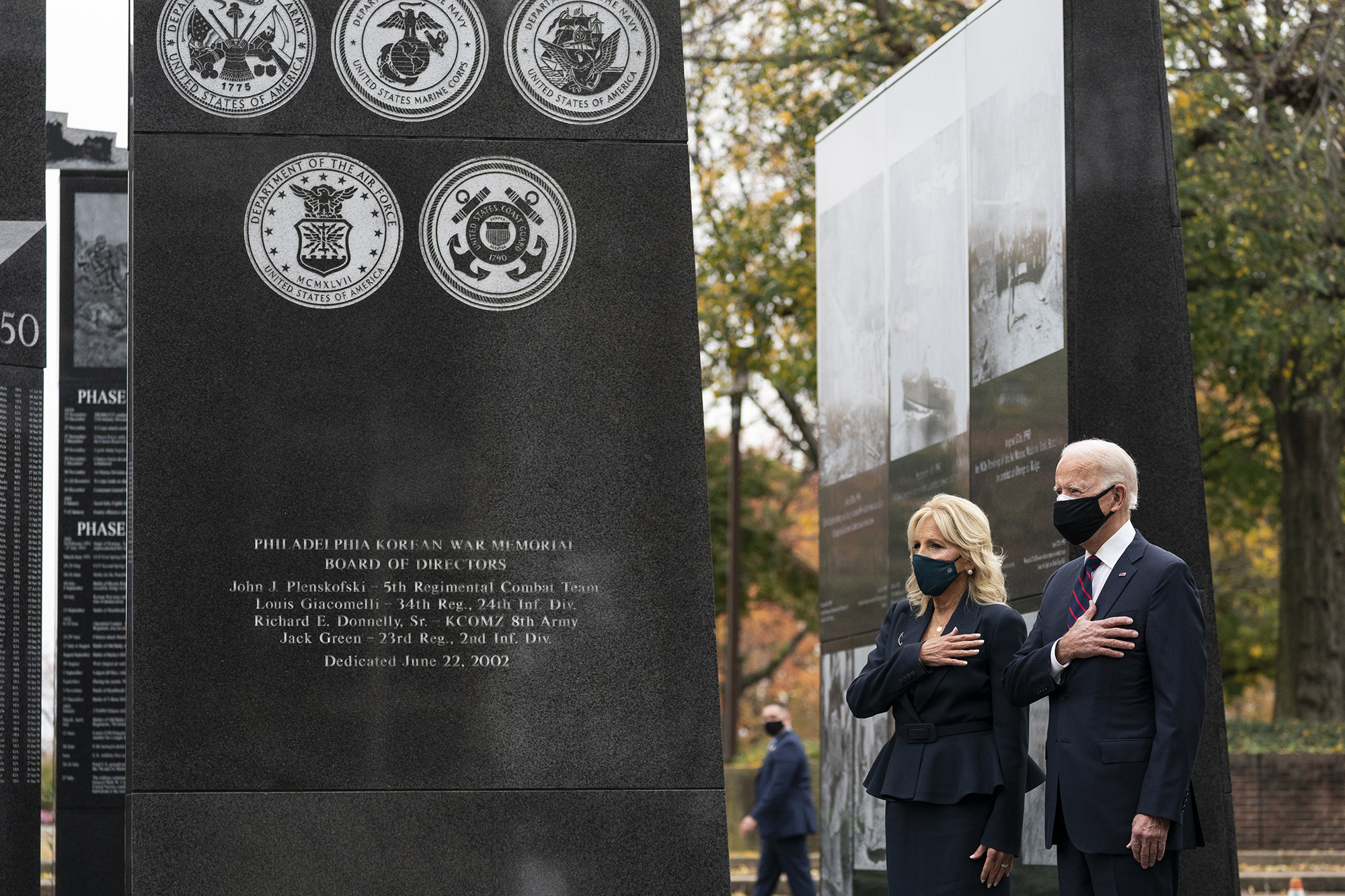 President-elect Joe Biden, and Jill Biden, stand with their hands over their hearts before placing a wreath at the Philadelphia Korean War Memorial at Penn's Landing, on Veterans Day, Wednesday, Nov. 11, 2020, in Philadelphia. (Alex Brandon/AP)